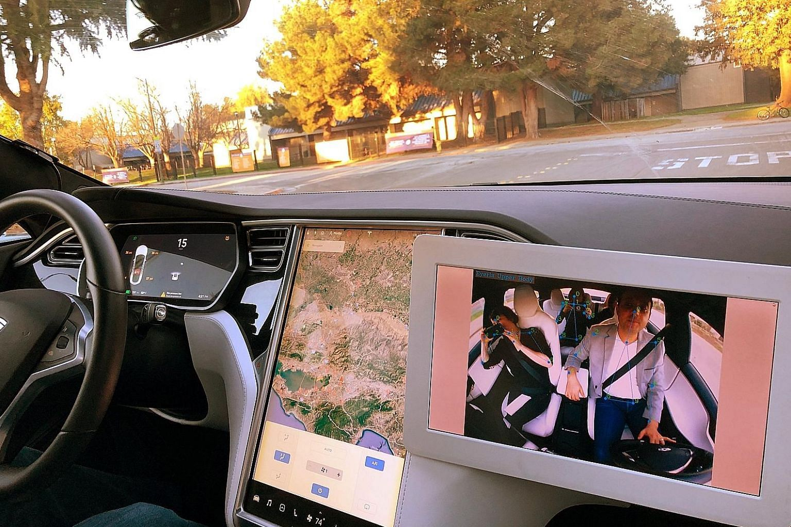 Occupants in a car are seen on a monitor using technology by Silicon Valley company Eyeris Technologies, which uses cameras and artificial intelligence to track drivers and passengers for safety benefits. Eyeris showcased the technology at this year'