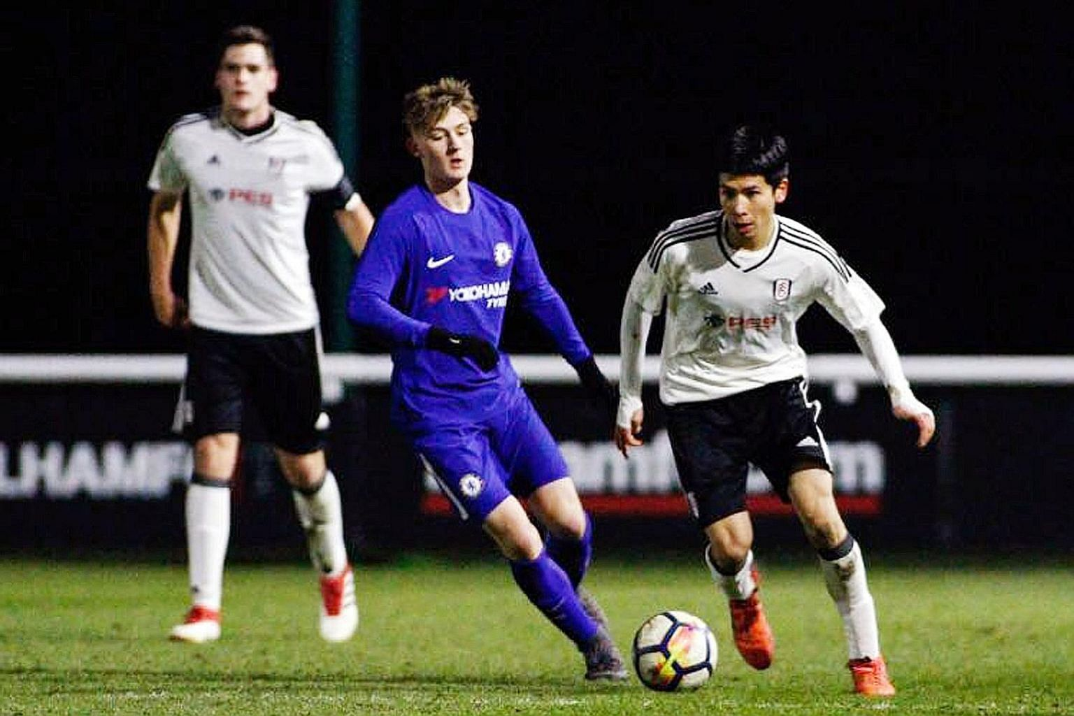 Singaporean footballer Ben Davis (at right) during a Fulham Under-18 match against Chelsea. The teenager's appeal for deferment had sparked a national debate last year. He is the first Singaporean to sign professional terms with an EPL team.