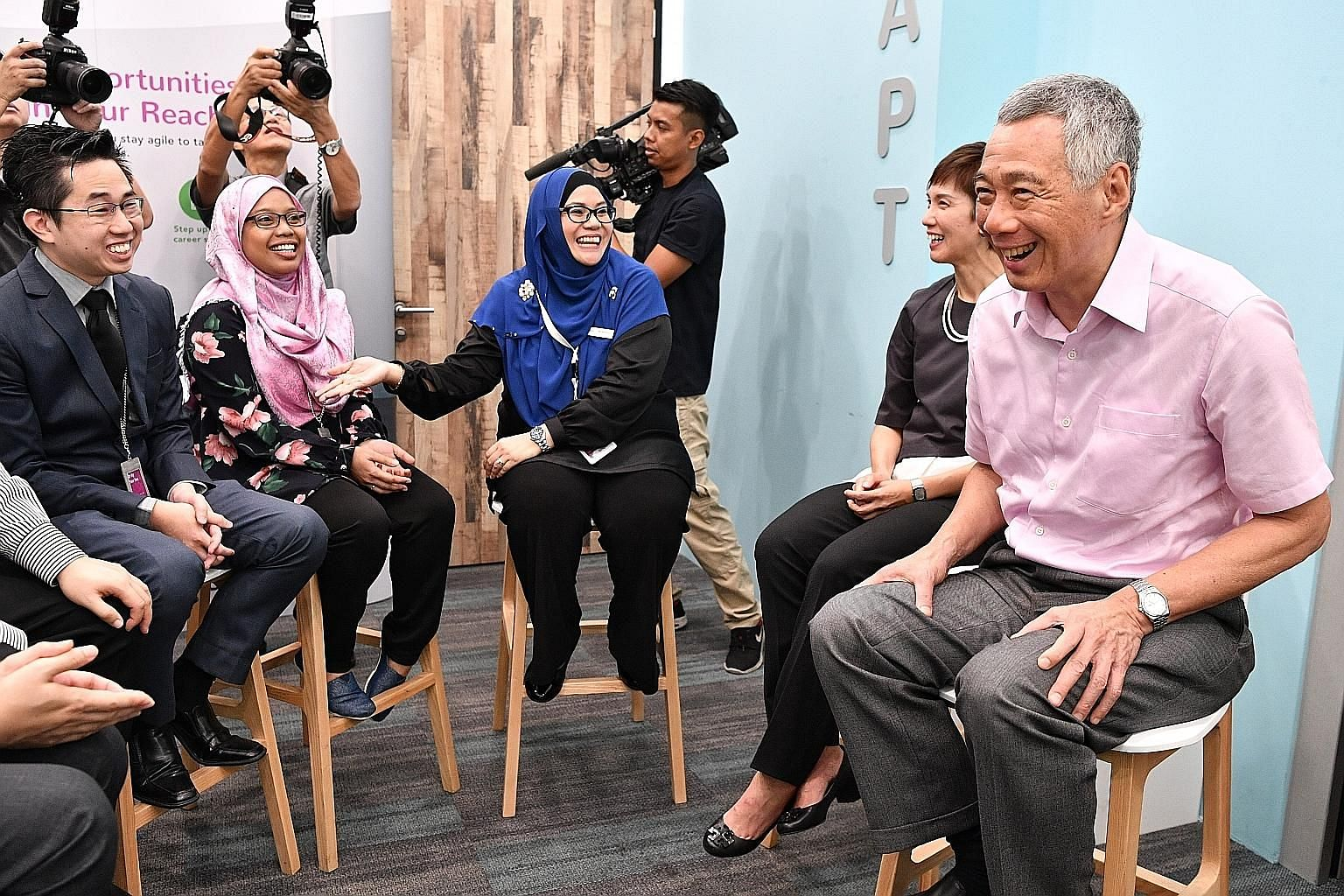 (From far right) Prime Minister Lee Hsien Loong and Manpower Minister Josephine Teo chatting with career coach Noralizah Aziz, assistant staff nurse Suriana Sarip and her employer, Dr Ng Yew Yee. Ms Suriana was an administrative assistant who took a