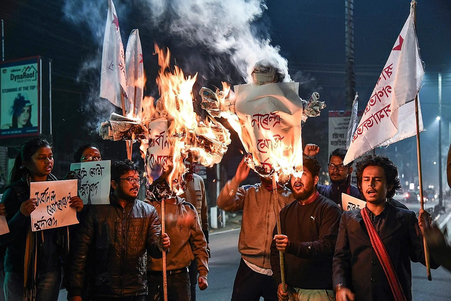Activists burning effigies of India's Prime Minister Narendra Modi and Assam's Chief Minister on Tuesday after the country's Lower House of Parliament passed a Bill granting citizenship to non-Muslim migrants from three neighbouring countries, includ