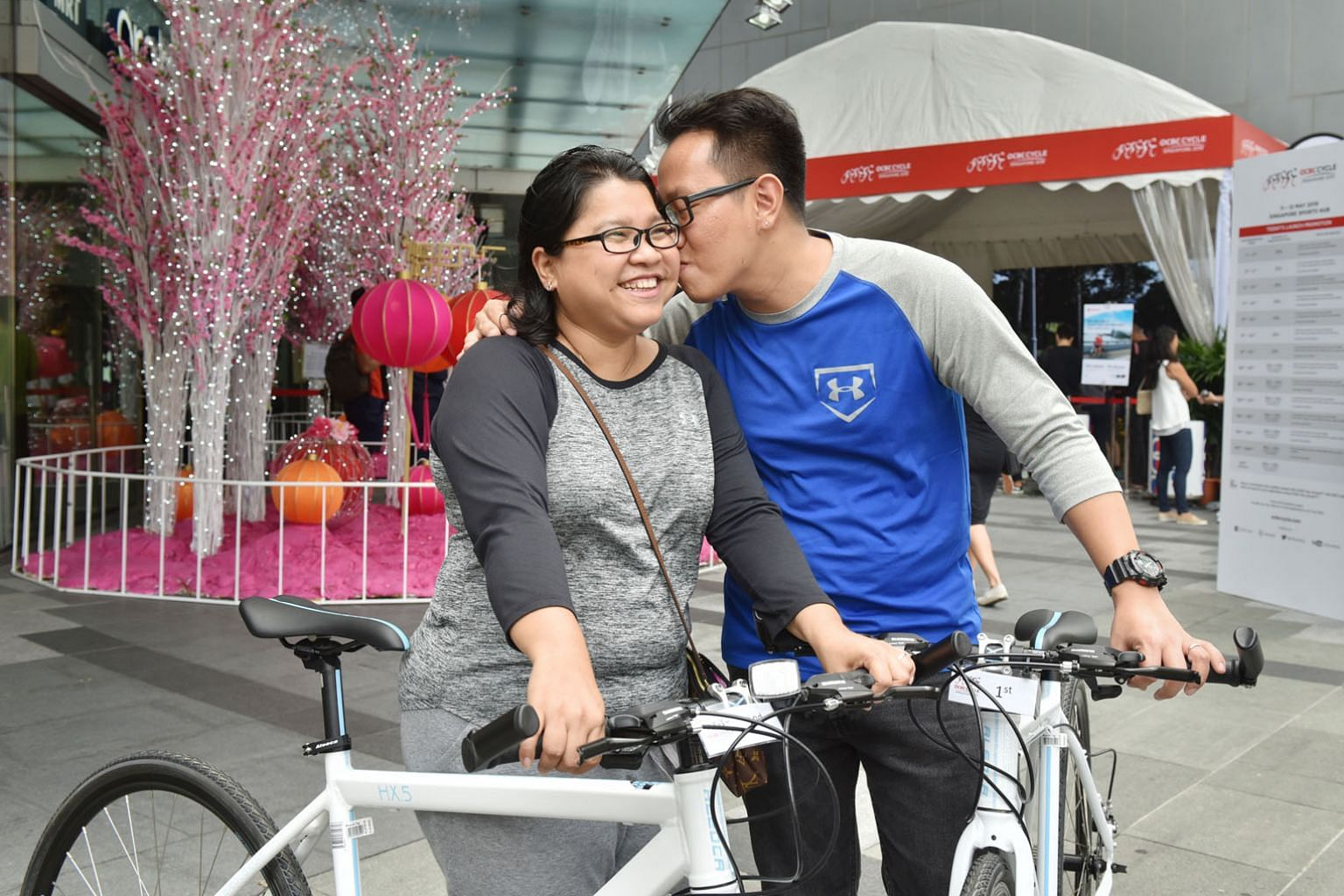 Michelle Myat and husband Bryan Phyo with the bikes they received as gifts for being the first two people in the queue to register for the OCBC Cycle event.