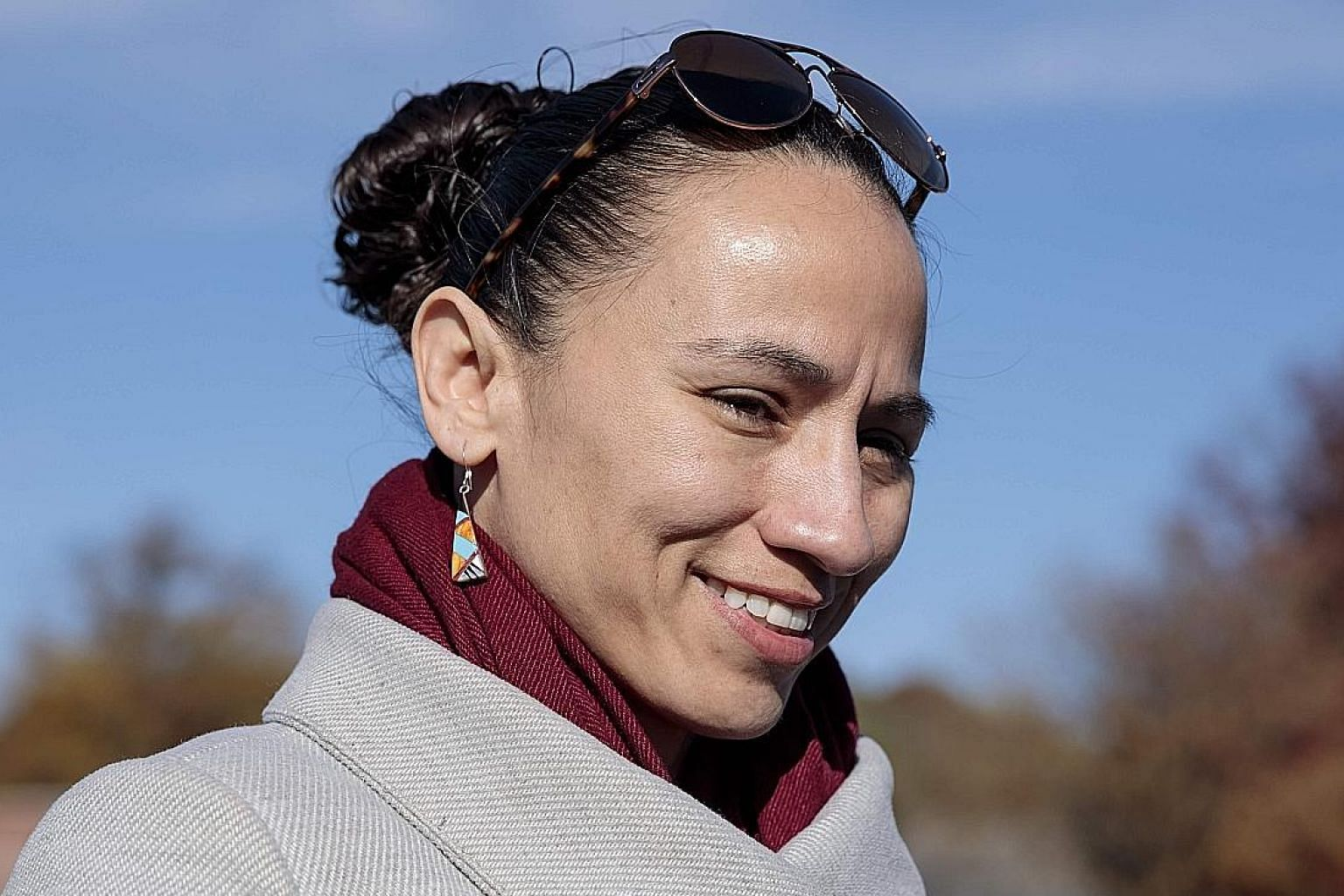 Ms Sharice Davids made history when she became one of the first two Native American women to be elected to Congress.