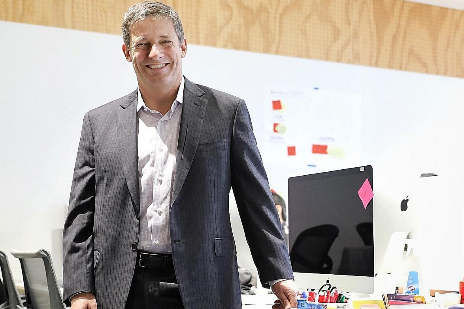 Pivotal CEO Rob Mee at the Robinson Road office. As in the US, staff in Singapore, after a free breakfast, gather for a meeting at 9.06am every day where ideas are tossed around and someone brings up an interesting thing he has learnt about. 9.06 was