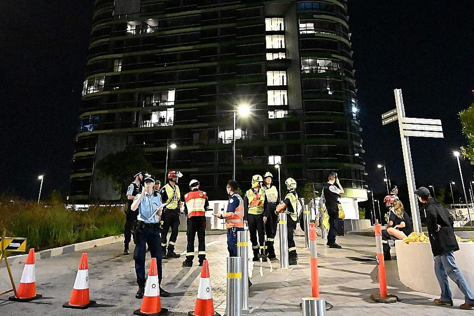 Police and firefighters in front of Opal Tower in Sydney on Christmas Day, after residents of the 36-storey building were evacuated the night before, when cracking sounds were heard.