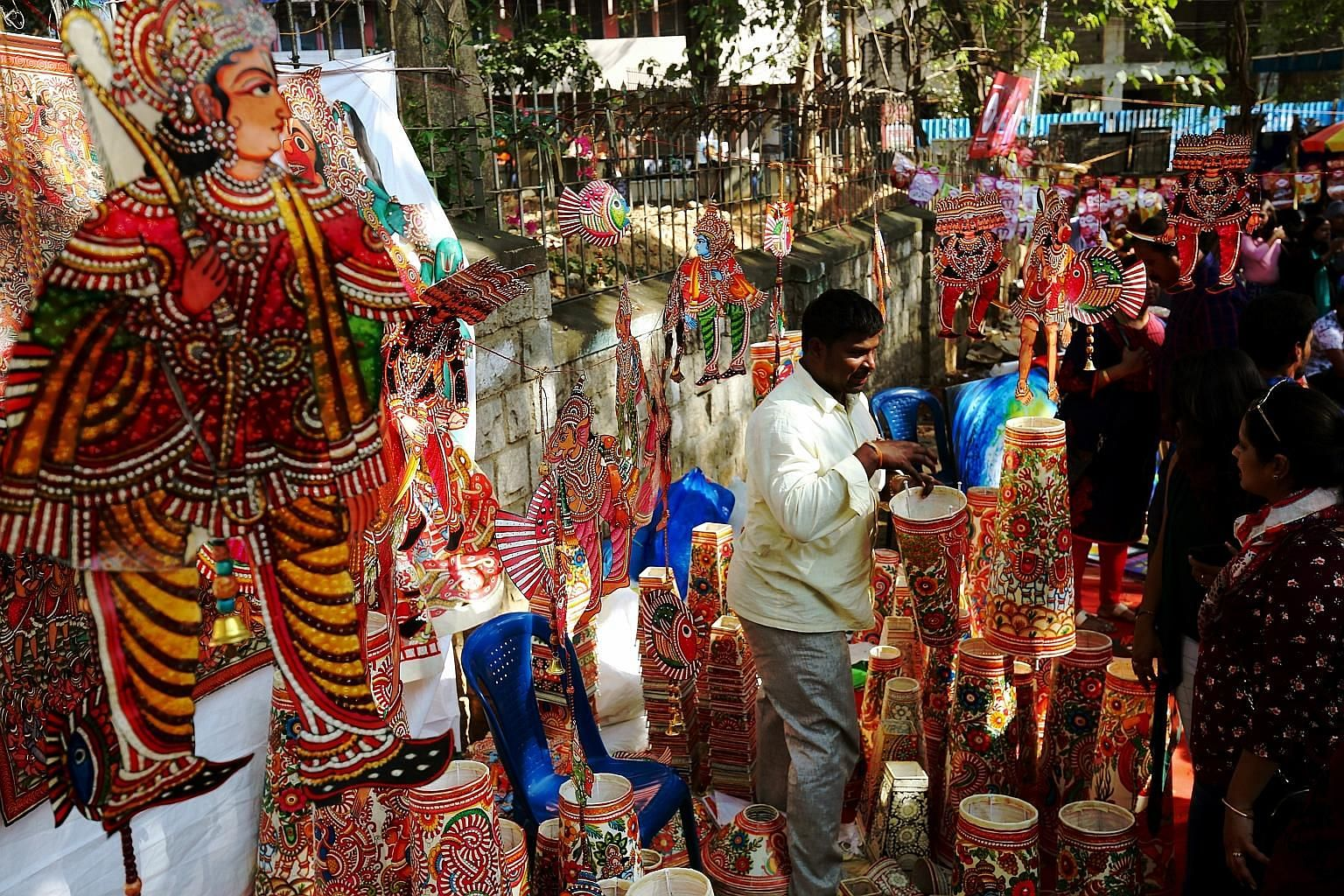 A roadside art fair in Bangalore. India is close to 50 per cent urban but considers itself a nation of villages, say the writers. They add that this seriously affects the country's growth prospects, leading to inefficiencies and loss of productivity