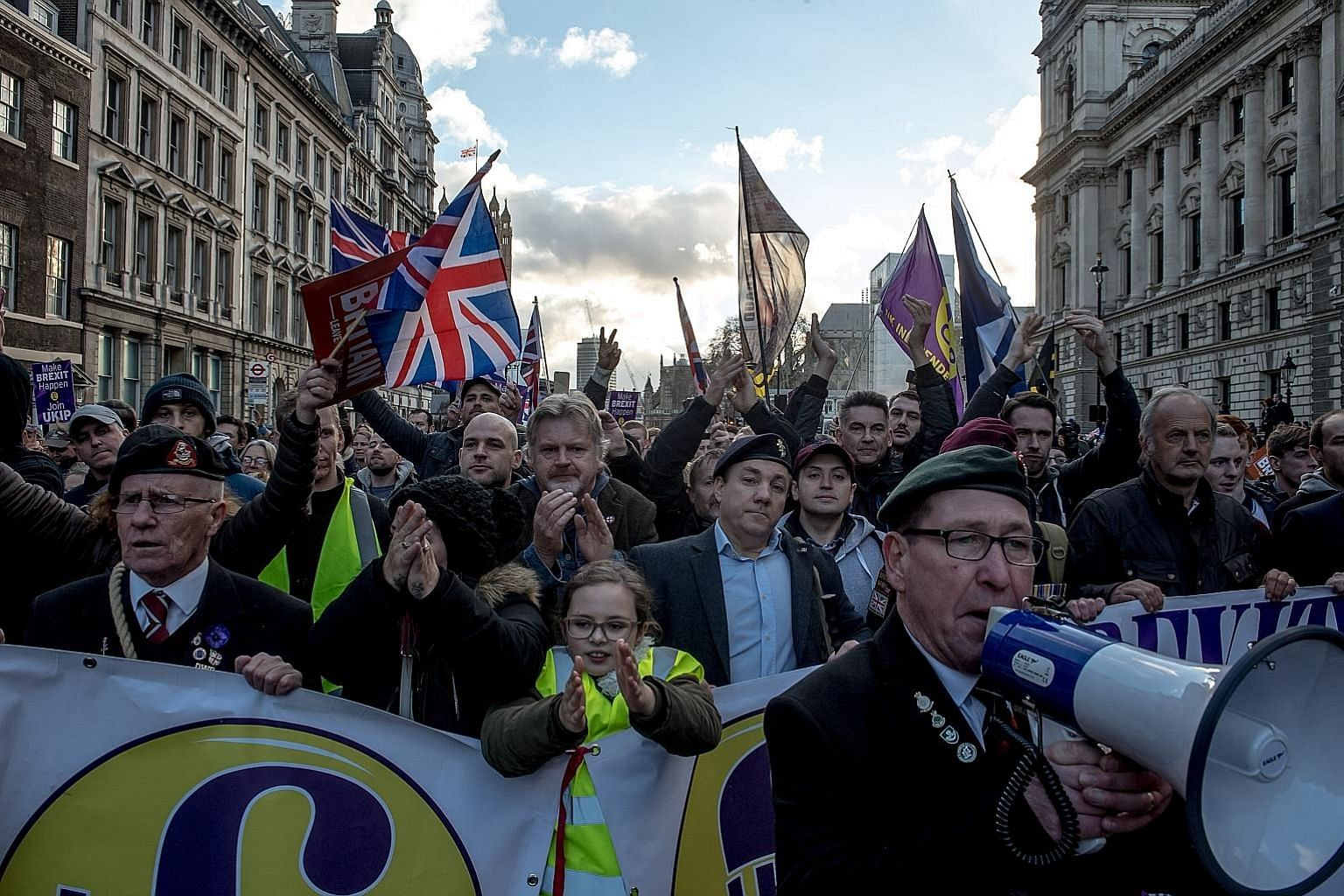 Demonstrators at a pro-Brexit rally in London last month. British Premier Theresa May is trying hard to make a chaotic no-deal Brexit seem as if it is an inescapable force of nature, says the writer. Yet it seems unlikely she would embrace the chaos