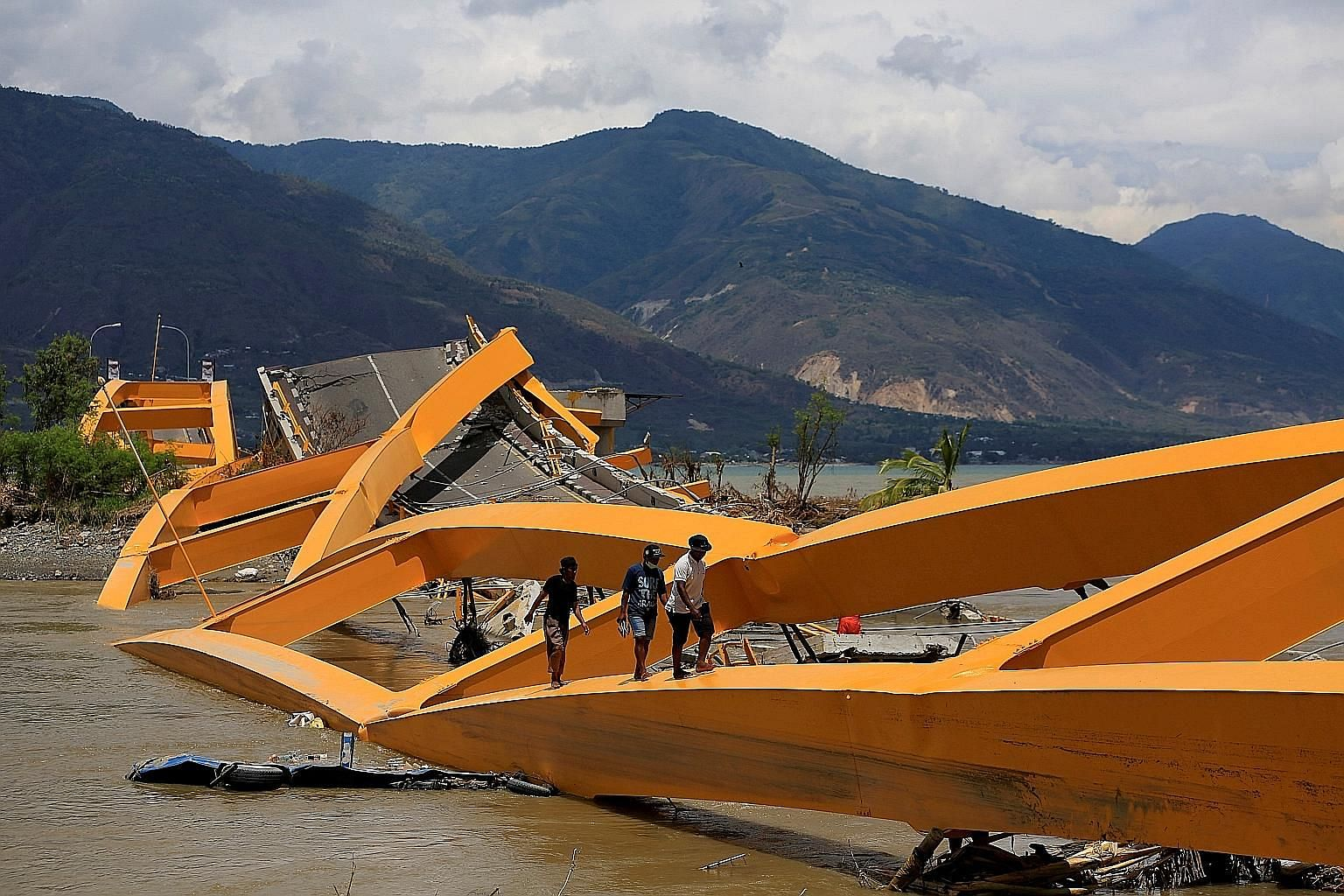 A road bridge in ruins after it was hit by an earthquake and tsunami in Palu, Sulawesi island, Indonesia, in October last year. At least 37,000 schools nationwide are located in disaster-vulnerable regions and the Indonesian authorities want to bette