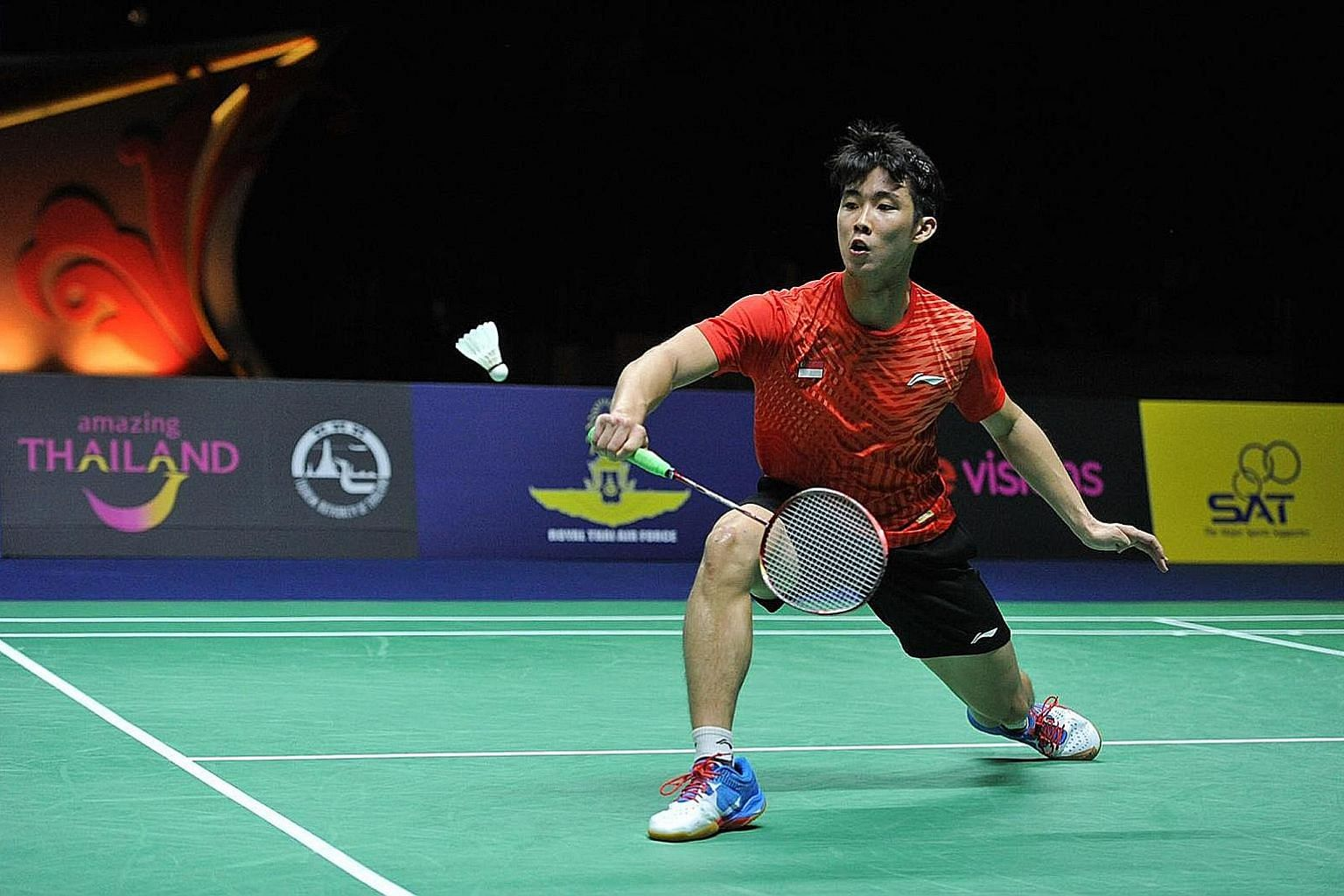 Loh Kean Yew en route to his 21-19, 21-18 victory over two-time Olympic champion Lin Dan in the Princess Sirivannavari Thailand Masters men's singles final in Bangkok yesterday.