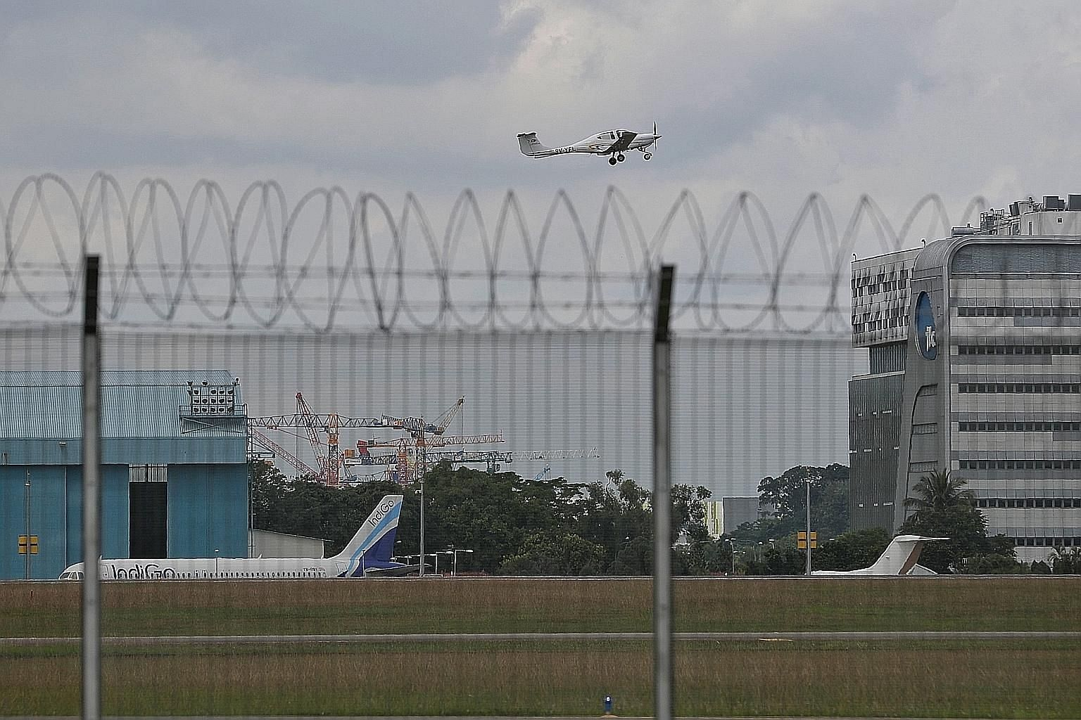 The new Instrument Landing System (ILS) uses the exact same flight path that aircraft landing at Seletar Airport (left) have used all along for visual flights. The only difference is with ILS, pilots can land even in bad weather, says Foreign Ministe