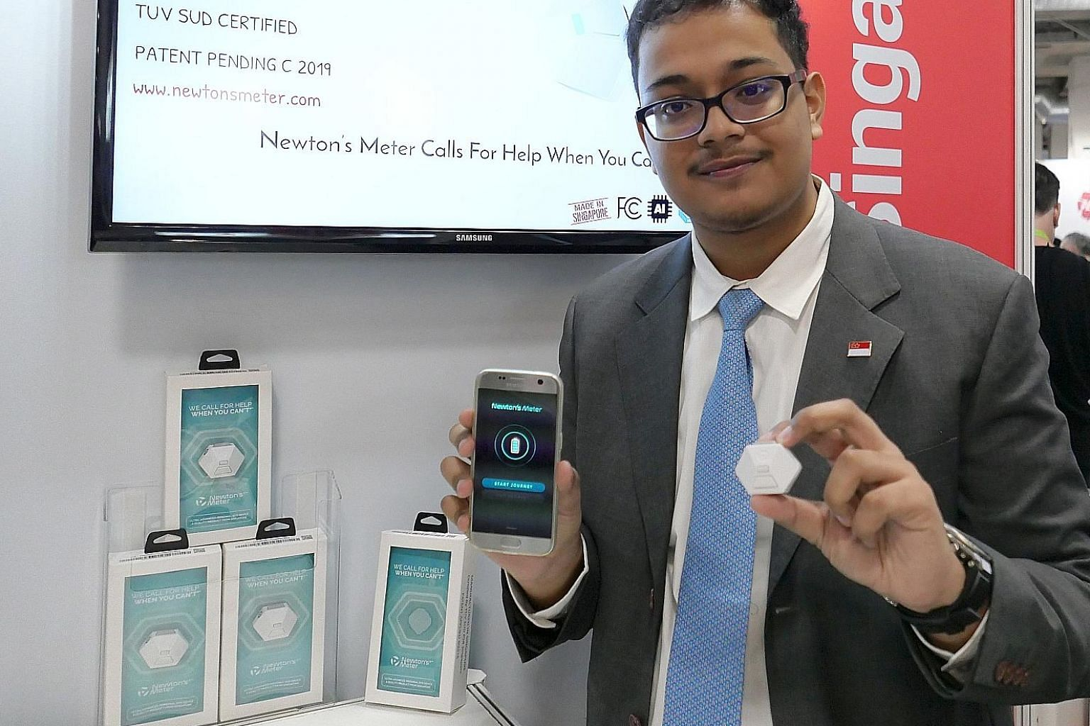 Sid Mazumdar with his Newton's Meter, an advanced micro-electronic personal-safety device.