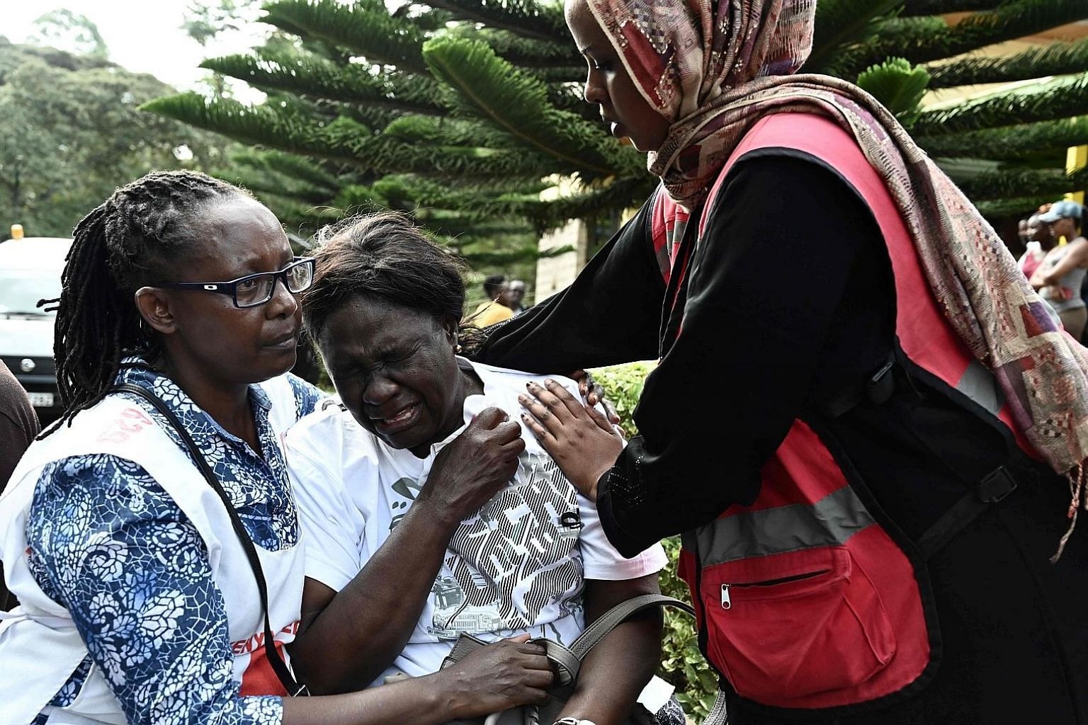 A woman in tears after identifying the body of a relative who was killed in the hotel siege in Nairobi.