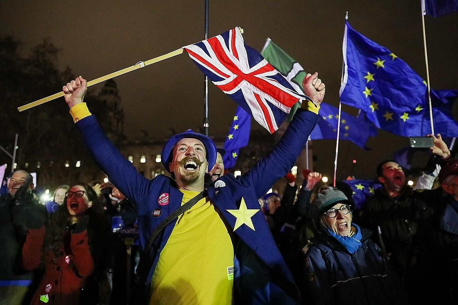 An anti-Brexit demonstrator reacting to the result of the British Parliament's vote on the Brexit deal in London on Tuesday. Pro-Brexit activists were similarly buoyed by the defeat of Prime Minister Theresa May's deal, but for different reasons - th
