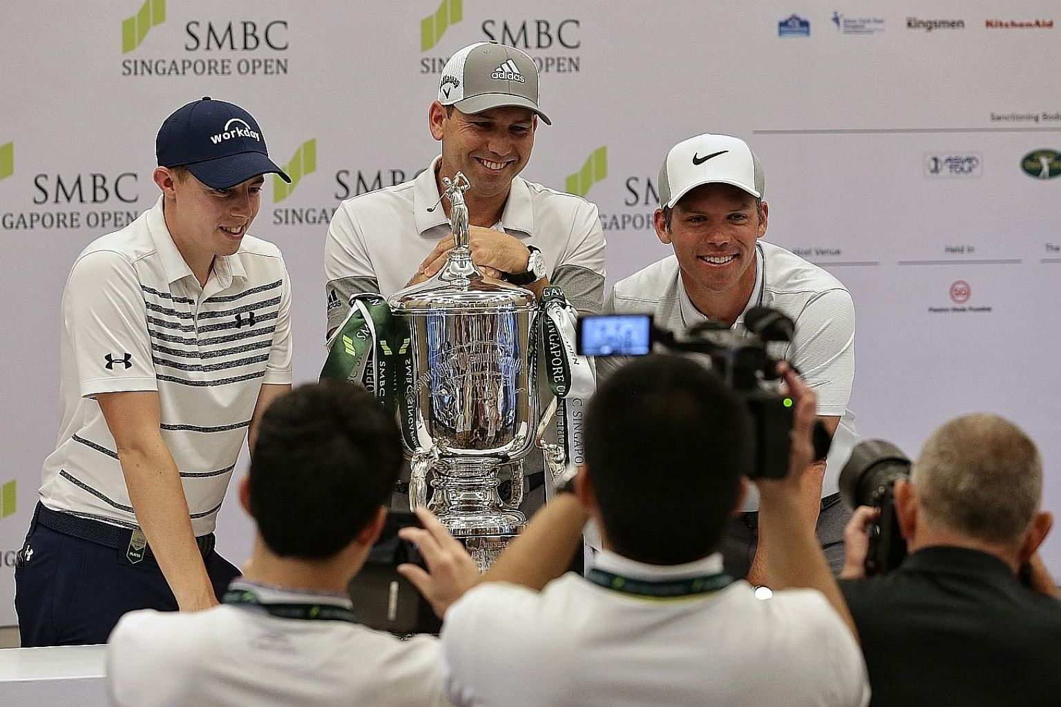 Defending champion Sergio Garcia, flanked by Englishmen Matthew Fitzpatrick (far left) and Paul Casey, playfully showing his reluctance to hand back the trophy during Tuesday's press conference. The home contingent for the SMBC Singapore Open at the