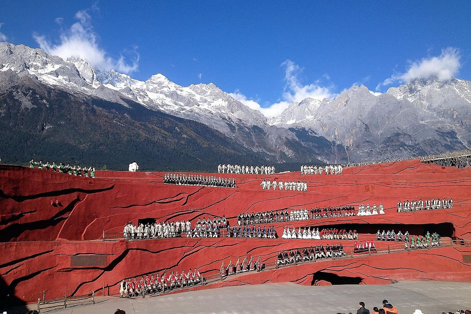 """The 500-man """"Impression Lijiang"""" show in China's Yunnan province features the Jade Dragon Snow Mountain in the background. It is directed by renowned film director Zhang Yimou, and is a main tourist attraction in Lijiang."""