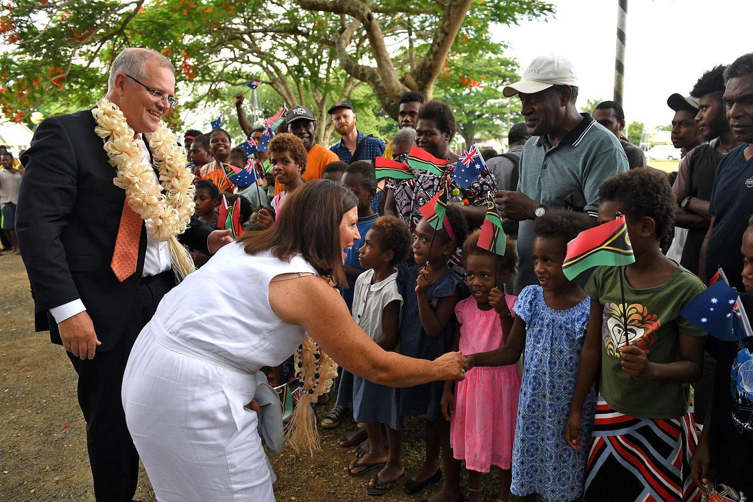 Australian Prime Minister Scott Morrison and his wife, Mrs Jenny Morrison, being welcomed to the National Archives and Library in Port Vila, Vanuatu, by residents yesterday.