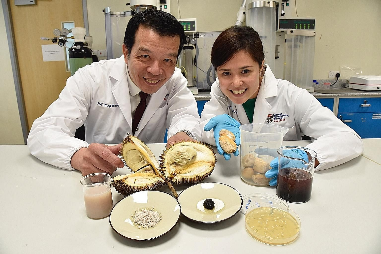 Professor William Chen, director of Nanyang Technological University's food science and technology programme, Dr Jaslyn Lee, NTU research fellow, and their team turned food waste into usable products.