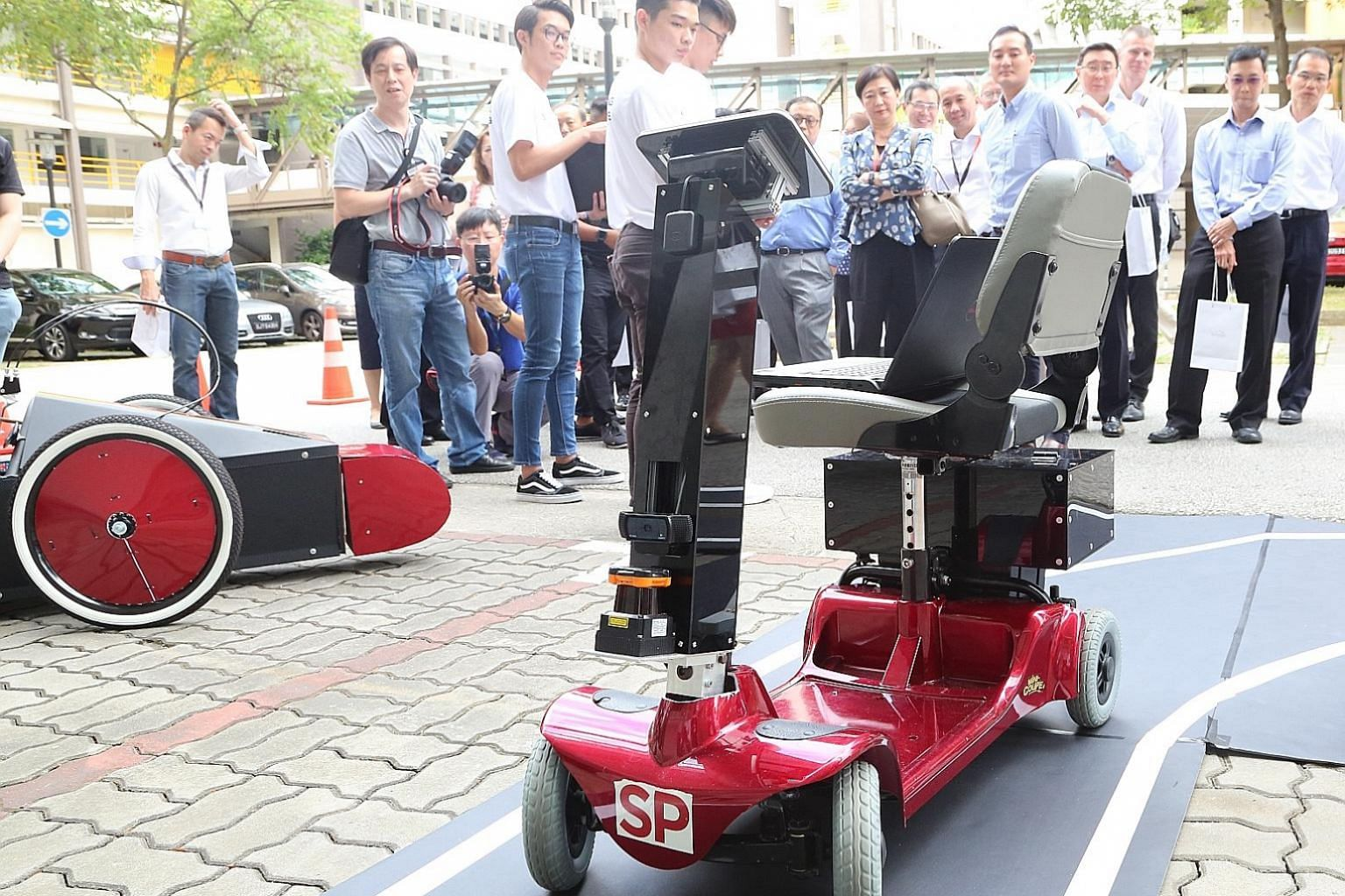 Engineering students from Singapore Polytechnic demonstrating how their project, SP Driverless And Electrifying Car, works at Singapore Polytechnic Engineering Show 2019 and 5G Garage opening event yesterday.