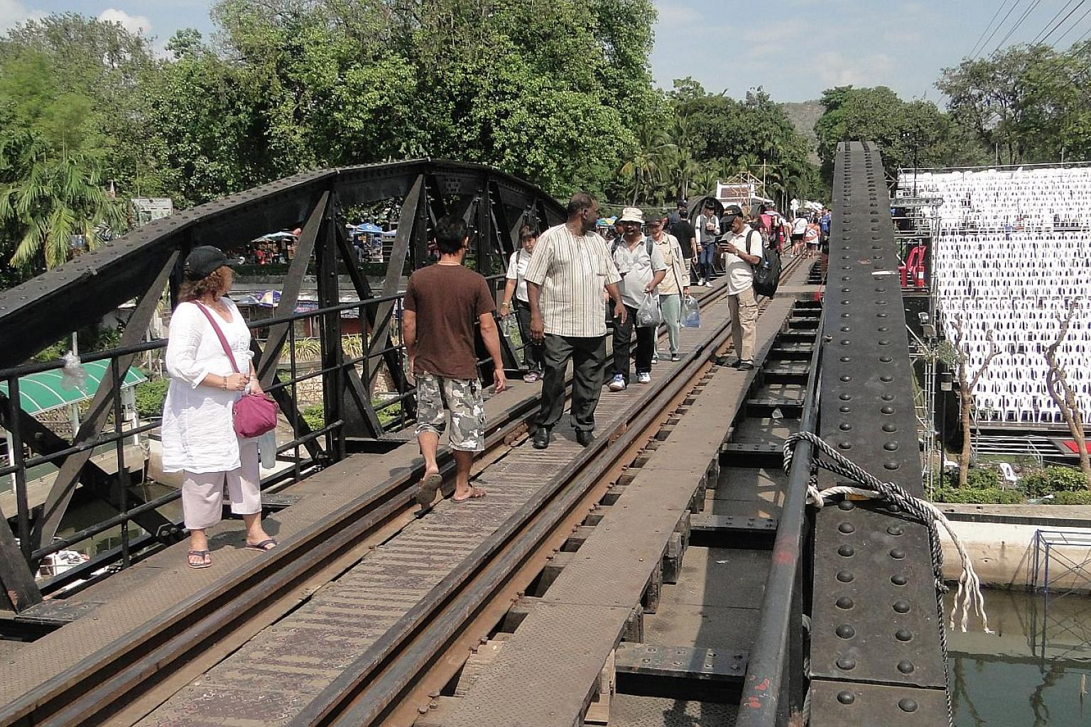 "Participants of a tour conducted by the Death Railway Interest Group on the famous Bridge on the River Kwai in Thailand last month. Above: Nong Pladuk station, the starting point of the Siam-Burma ""Death"" Railway on the Thai side. Left: Among those w"