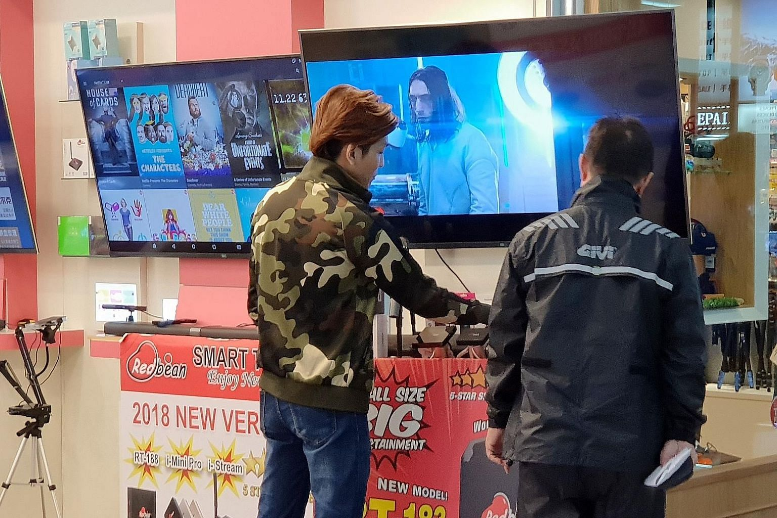 Streaming set-top boxes, which help consumers access pirated content, are openly promoted and sold at shops at Sim Lim Square. New laws to be tabled this year will ban the sale of such boxes.