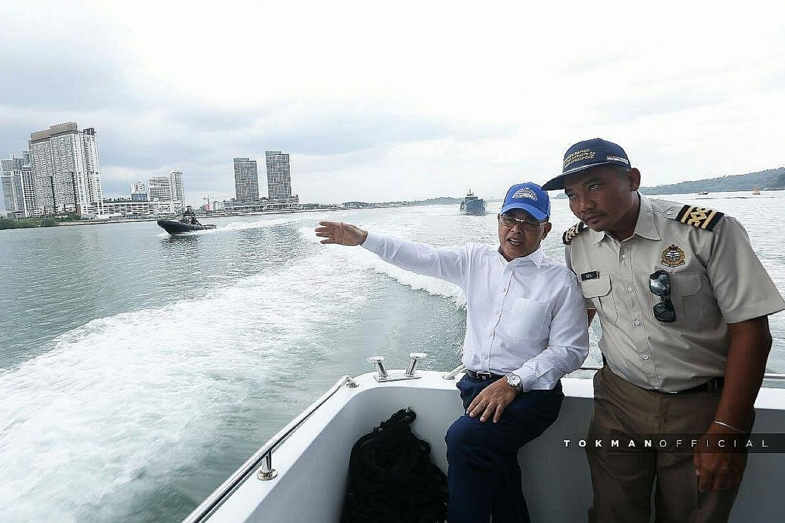 Johor Menteri Besar Osman Sapian (in white) visited a Malaysian government vessel anchored in Singapore's territorial waters on Jan 9. An annual bilateral meeting between Singapore and Malaysia, set for the following Monday, was postponed following D