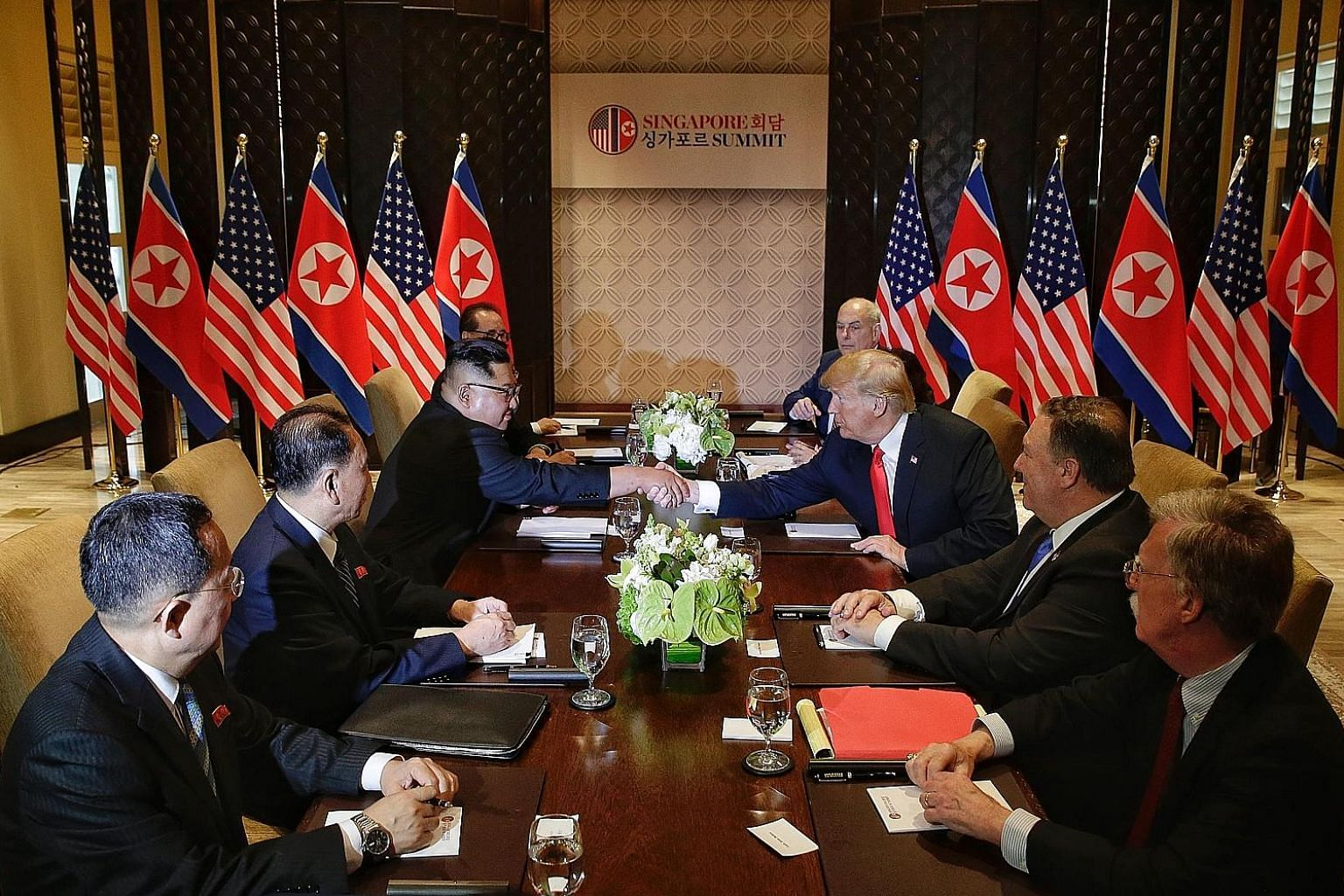 North Korean leader Kim Jong Un and United States President Donald Trump exchanging a handshake at a meeting held at Capella Singapore last June, during the leaders' historic first summit.