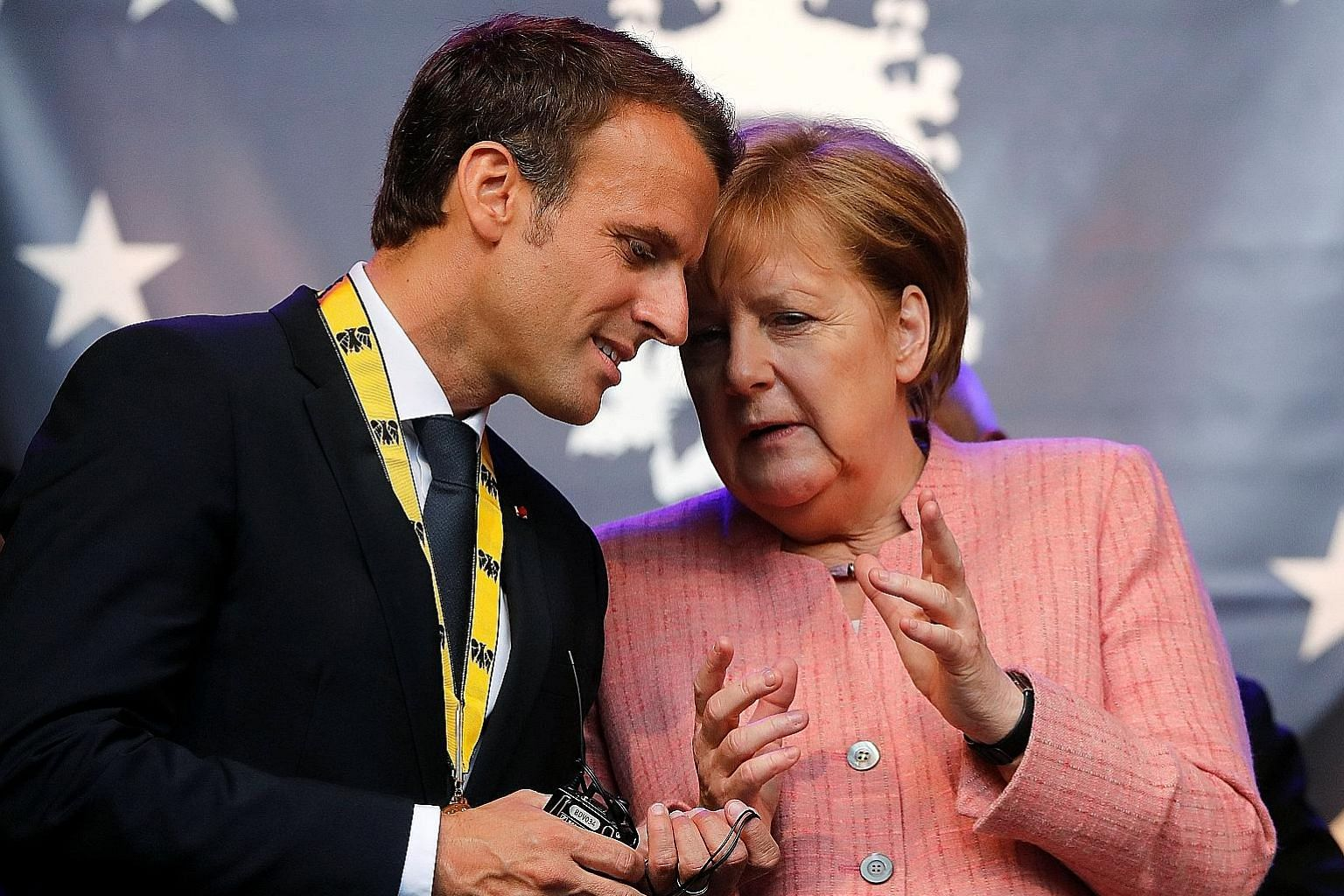 French President Emmanuel Macron with German Chancellor Angela Merkel after he was awarded the Charlemagne Prize in Aachen last year. In the German city next Tuesday, the two leaders will sign an agreement renewing the Elysee treaty of 1963.