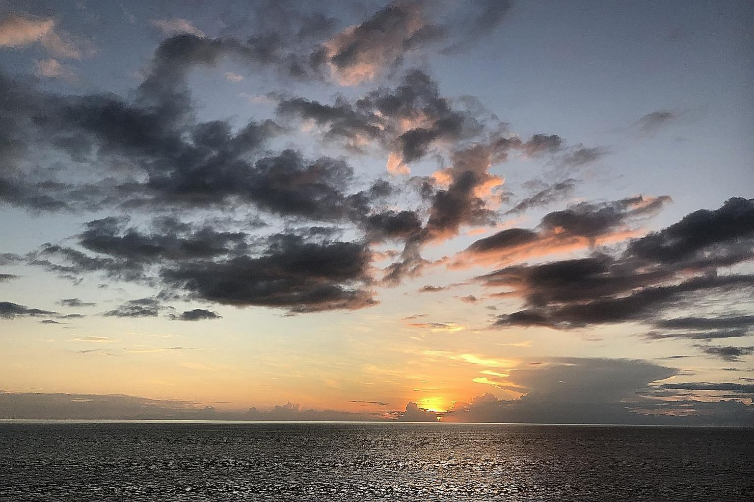 The Cocos Island off Costa Rica, with native birds in the foreground. During the voyage, the writer met people whose lives may appear simpler than those in the city but they are closer to what the natural world offers and make the most of it. Sunset