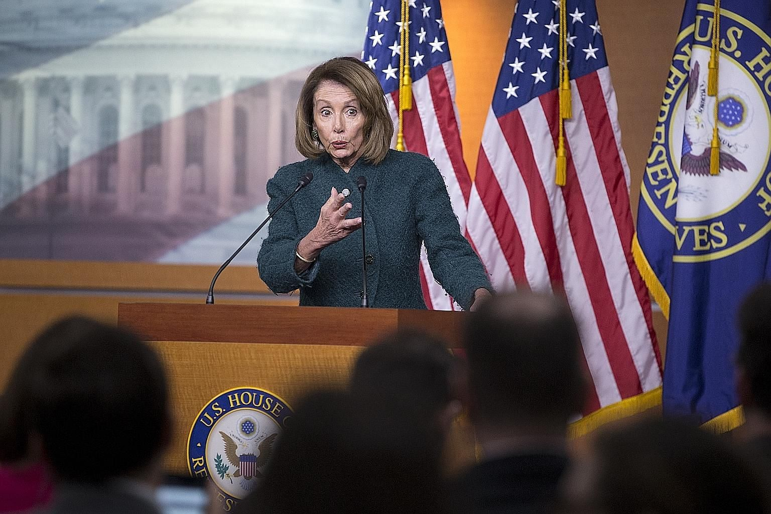 Democratic House Speaker Nancy Pelosi holding a news conference in Washington this month. The US' partial government shutdown has extended into a fifth week and remains at an impasse. Mrs Pelosi plans to have the House vote on its own border security