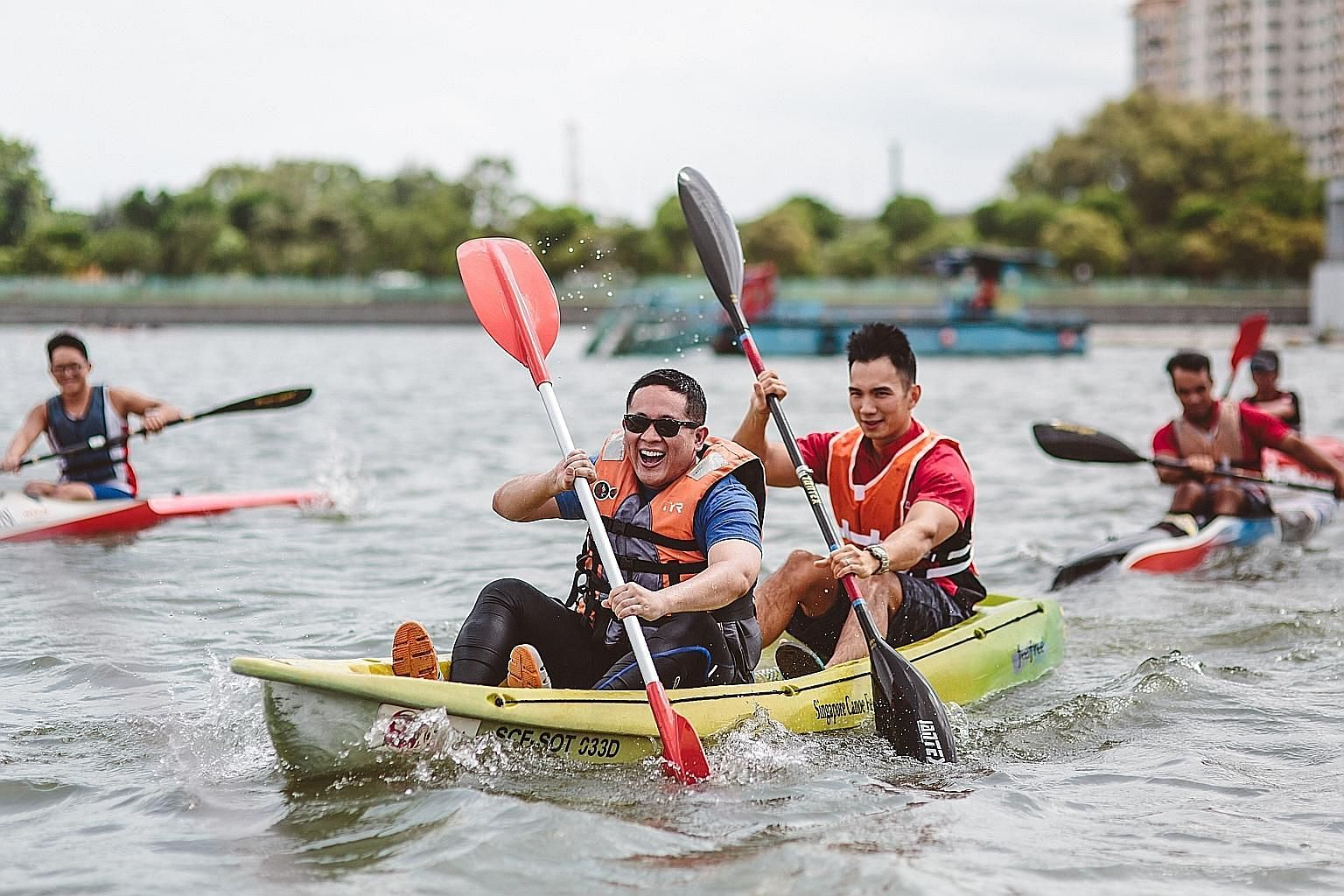 Some 800 competitors aged between seven and 60 took part in this year's Singapore Canoe Marathon at the Sports Hub's Water Sports Centre yesterday. The blazing conditions failed to dampen the spirits of the competitors, who paddled between 6km and 30