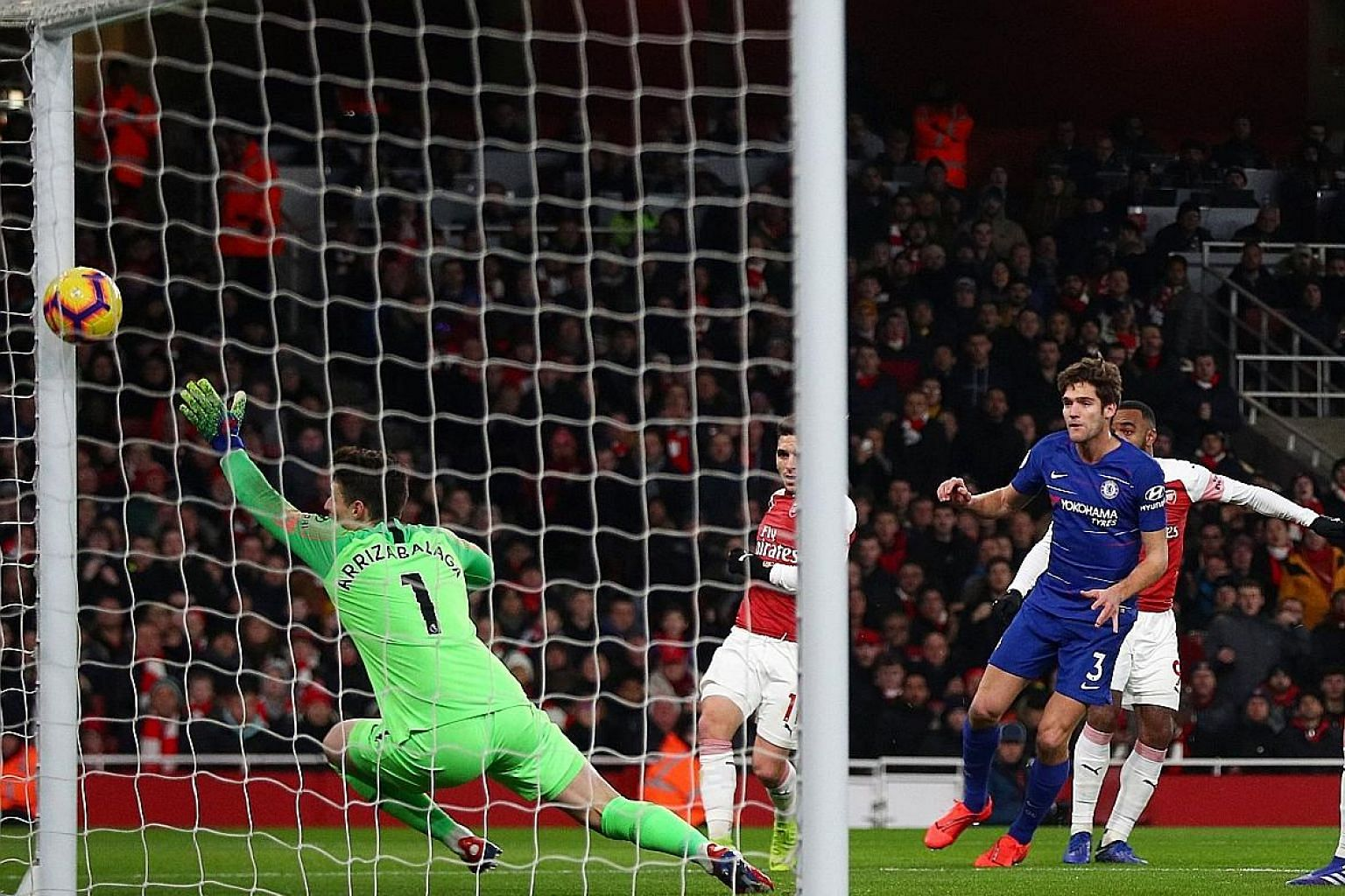 Alexandre Lacazette (right, partly hidden) scoring Arsenal's first goal against Chelsea on Saturday. The Blues lost 2-0 and manager Maurizio Sarri insisted it was his players' attitude, not his system, that was the problem.