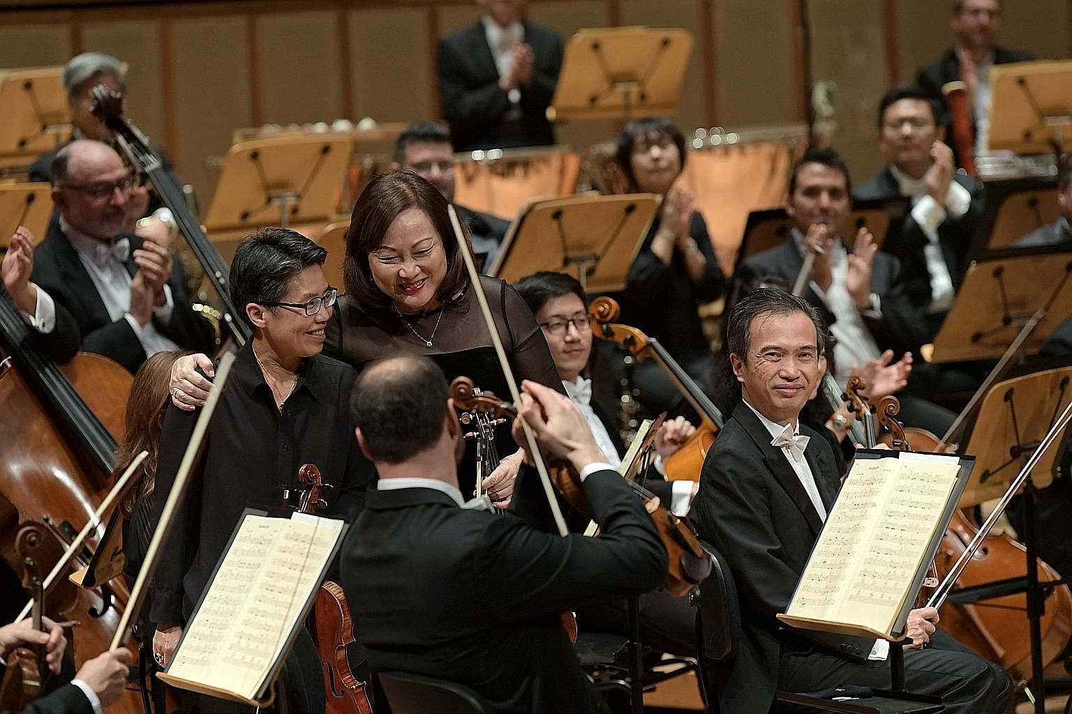 Musicians Lim Shue Chern (left) and Lynnette Seah receiving applause at the SSO 40th-anniversary concert.