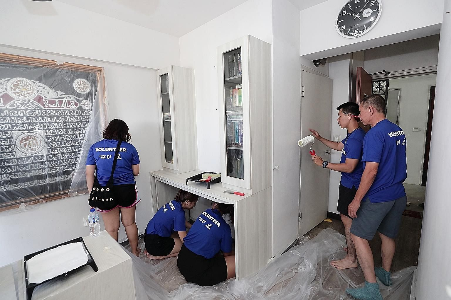 Volunteers at work in the home of a Tampines resident yesterday. It was part of an initiative called Project Refresh, which aims to encourage people of all ages to volunteer.