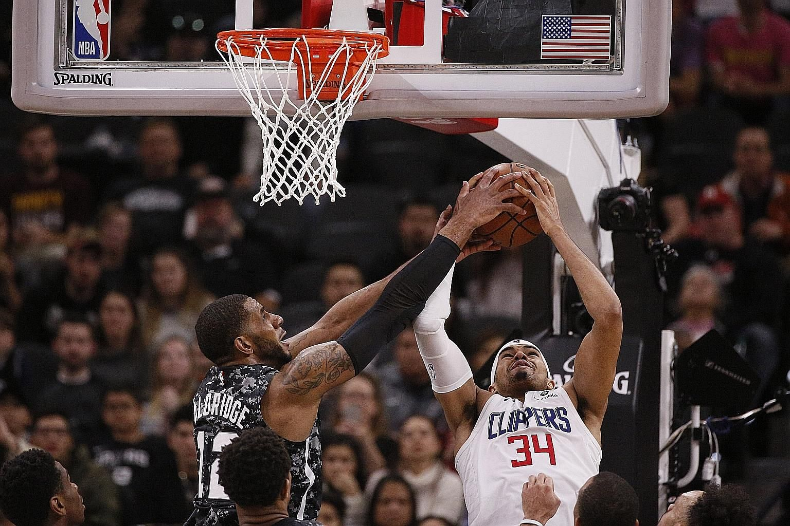 Los Angeles Clippers' Tobias Harris challenges San Antonio Spurs' LaMarcus Aldridge for a rebound. The Spurs centre led all scorers with 30 points but it was not enough to prevent the Clippers beating them 103-95 at the AT&T Centre in San Antonio.