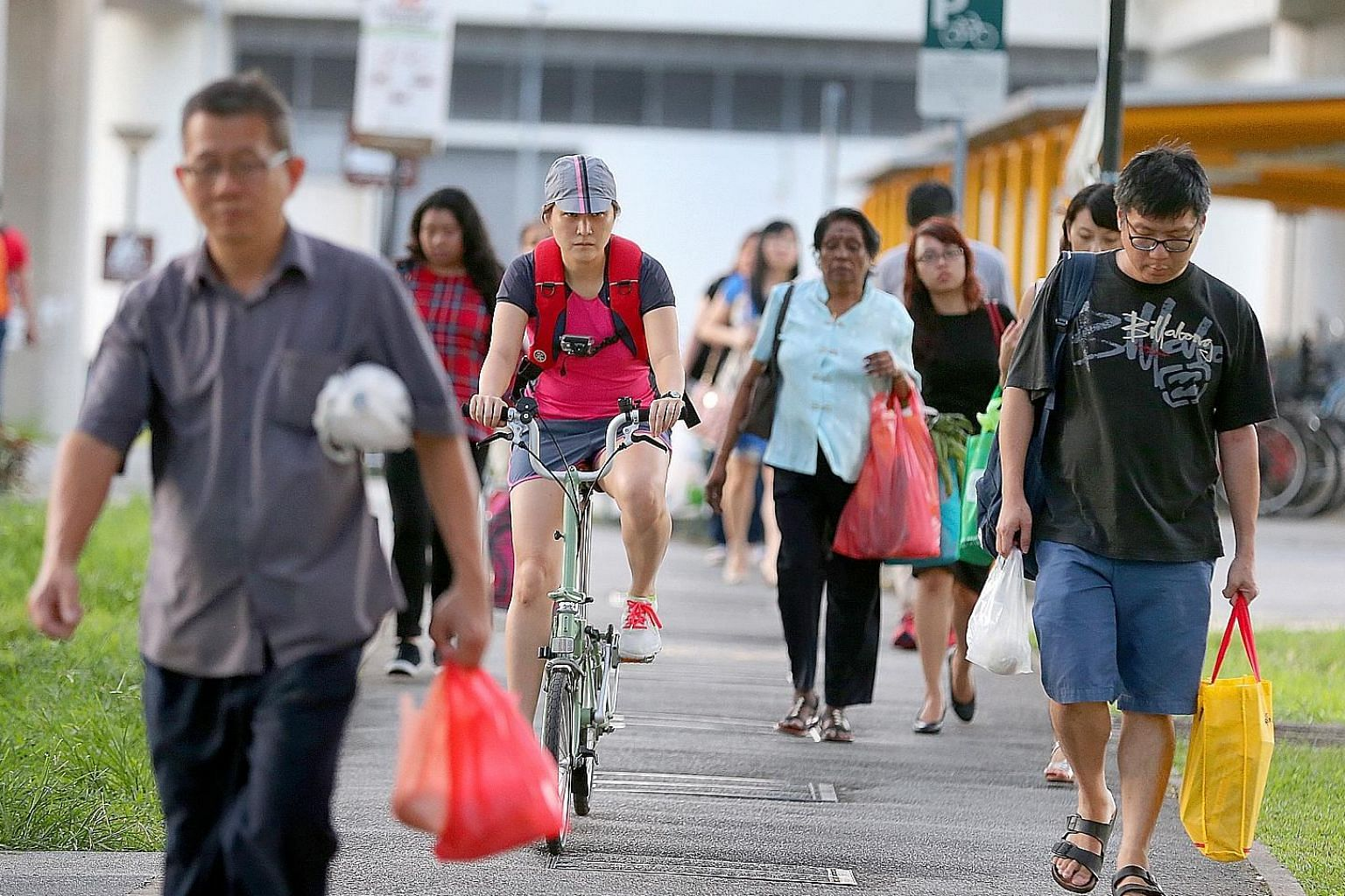 If Singapore were to promote cycling and the use of other mobility devices, it must do more than having rules govern their use on pedestrian walkways, says the writer. This is because having bikes and scooters on pathways will make walking less comfo