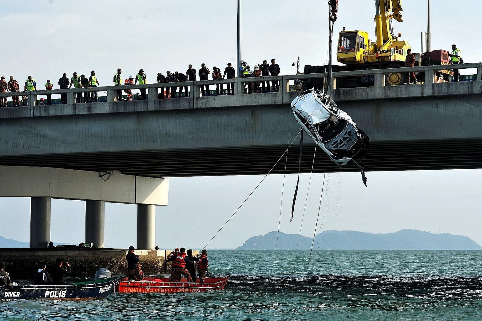 The recovery team used four cables attached to a crane to lift the Mazda CX-5 SUV, submerged at a depth of 15m, out of the water. The body of 20-year-old college student Moey Yun Peng was found in the driver's seat. The car had plunged into the sea a