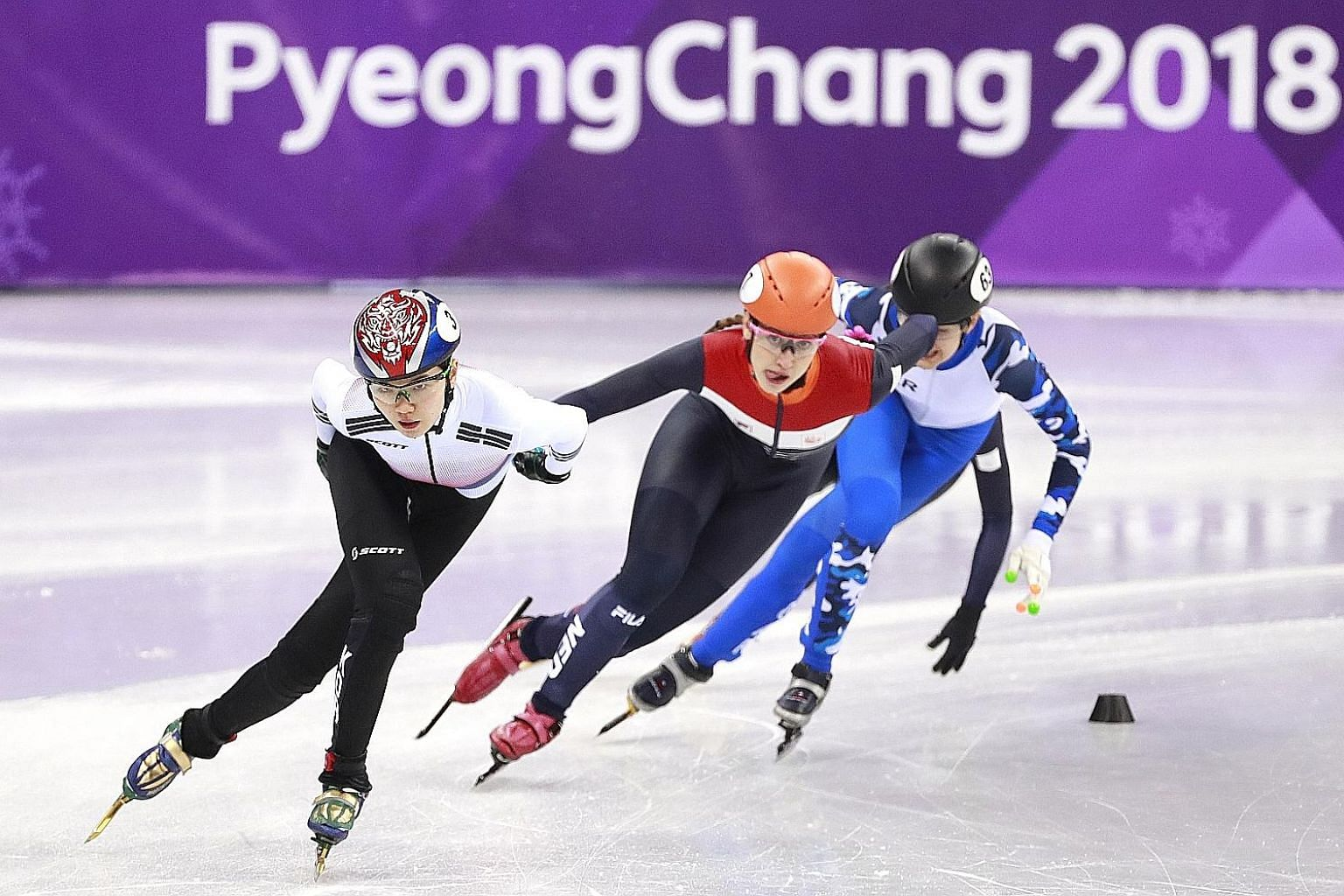 Shim Suk-hee (left) competing in the short track speed skating event at last year's Winter Games in Pyeongchang. The South Korean's accusation of sexual abuse against her coach led to his incarceration, while paving the way for more athletes with sim