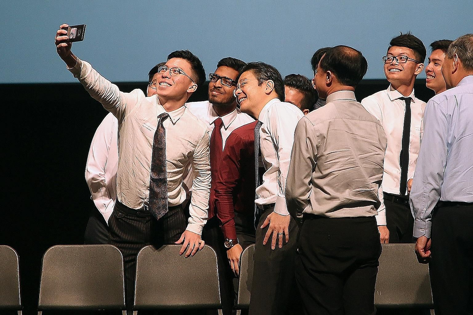 Scholarship and sponsorship recipients taking a wefie with National Development Minister Lawrence Wong (fourth from left) at the iBuildSG scholarship ceremony at the National University of Singapore yesterday.
