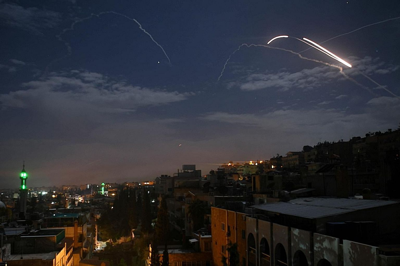 A handout photo from the Israel Defence Forces showing Iranian targets being attacked by the Israeli military in Syria on Monday. Syrian air defence batteries responding to what the state media said were Israeli missiles targeting Damascus on Monday.