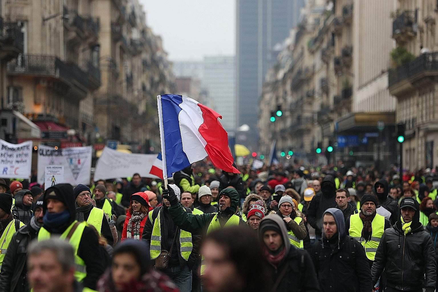Yellow vest protesters on the streets of Paris last Saturday. The protests against French President Emmanuel Macron's proposed increases in diesel fuel taxes are a sign that the bottom 50 per cent of French society has lost trust in him, says the wri