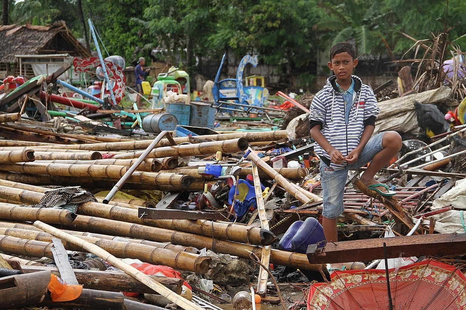 "The scene in Tanjung Lesung, Banten province, in the aftermath of the Dec 22 tsunami that hit the west coast of Java. In his call to involve the local communities, geologist Roger Scoon says they ""are more organised and technically skilled than we en"