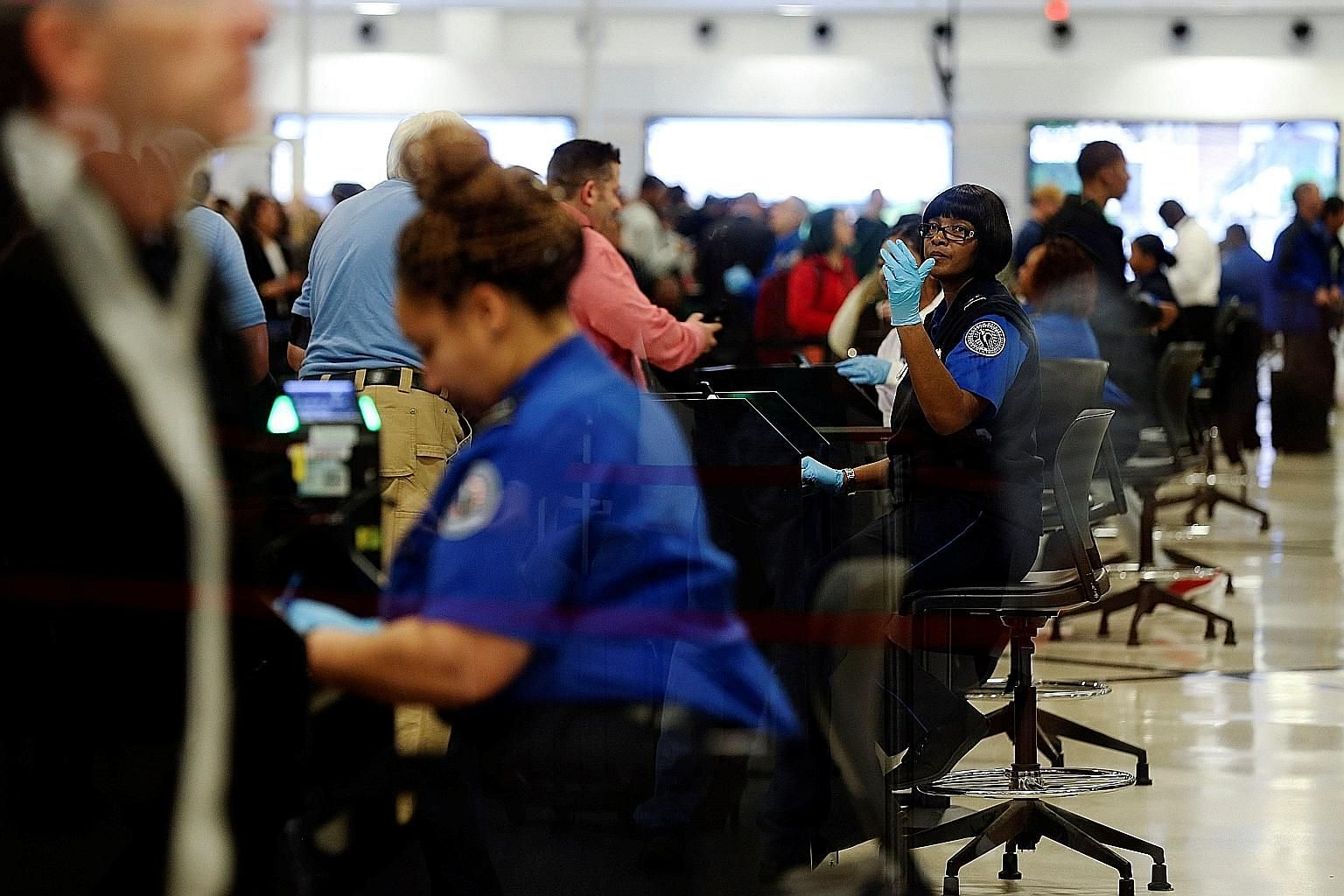 As many as one in every 10 transportation security officers has been failing to show up for work, and backup officers have had to be flown in to bolster depleted ranks at some airports because of the partial US government shutdown. A rising number of