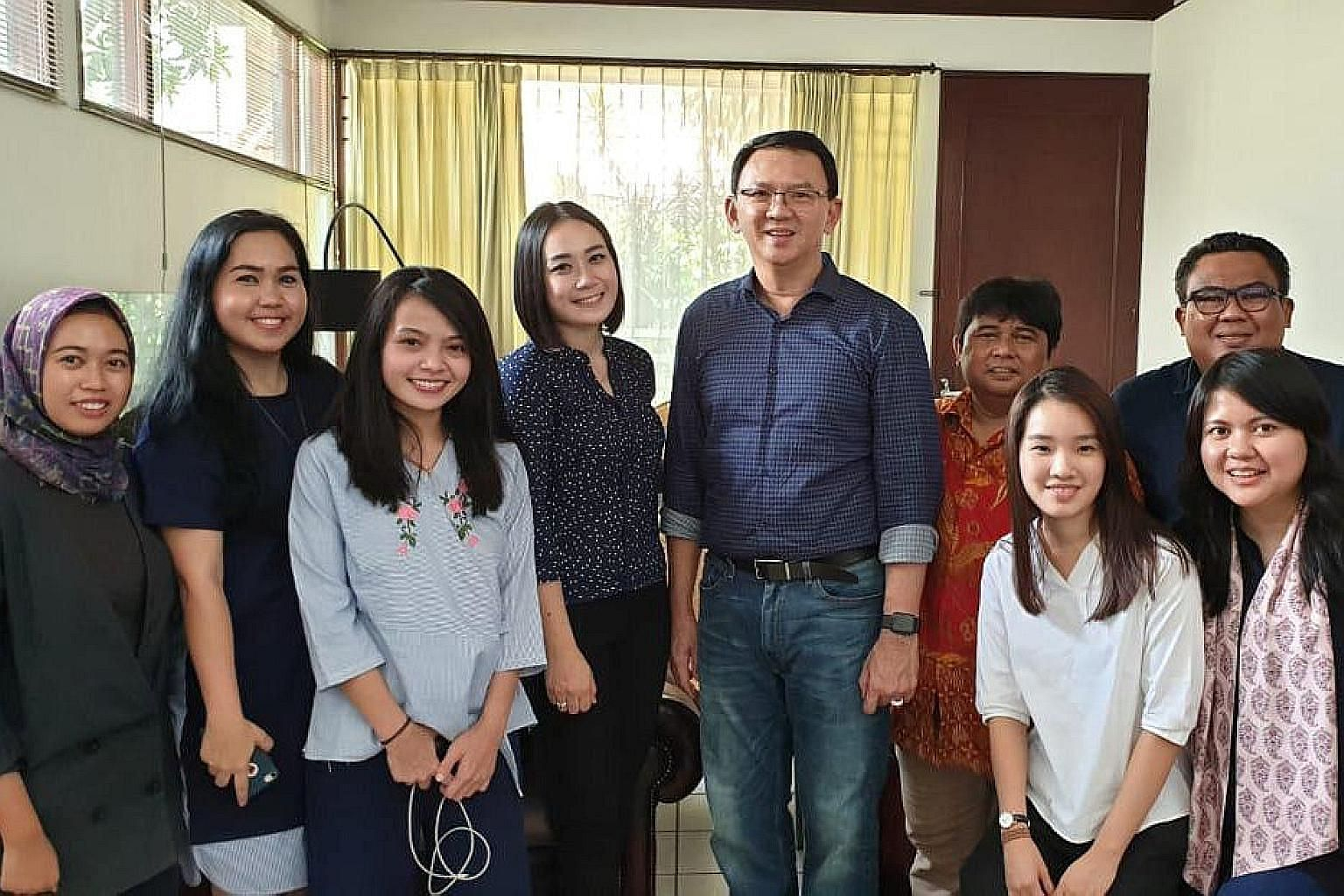 Former Jakarta governor Basuki Tjahaja Purnama is seen here in a photo by Antara Foto with his relatives after his release from prison yesterday. Media reports say marriage forms for his wedding have been submitted.