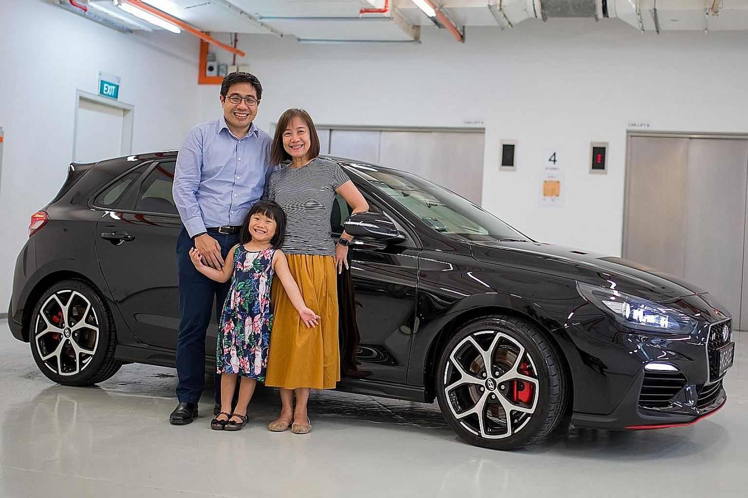 Mr Paul Goh, with wife Gwen and daughter Rachel, is drawn to the fact that the Hyundai i30N has a manual gearbox, which he finds more fun to use than an autobox.