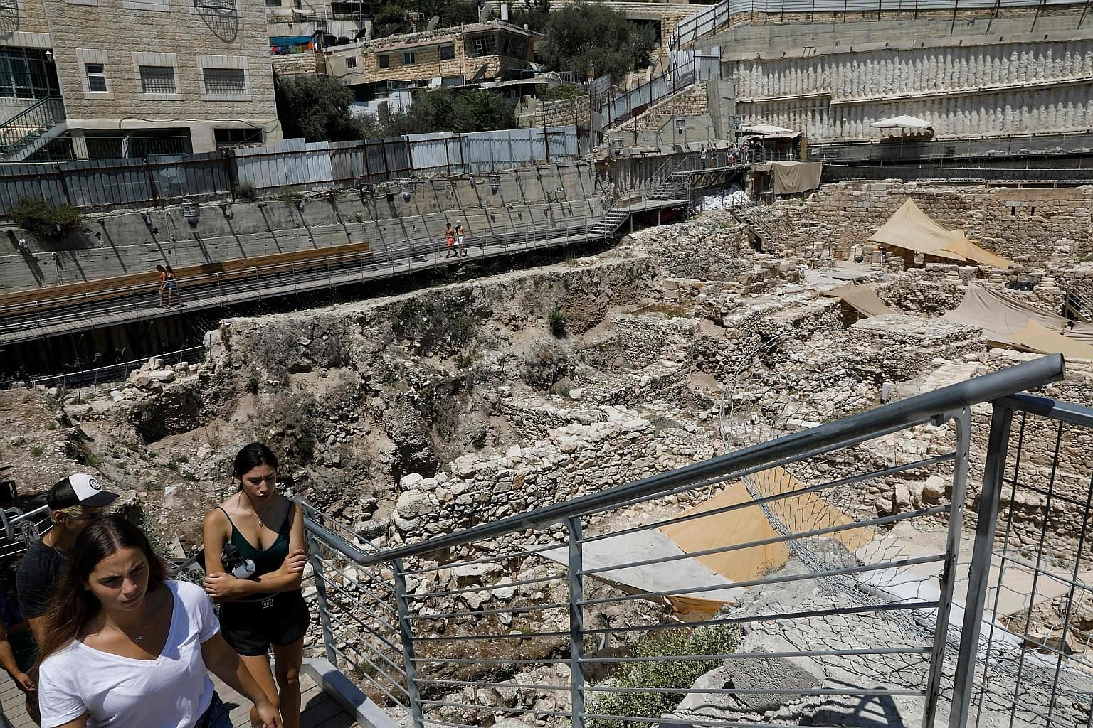 Tourists at the site where a rare golden earring, believed to be more than 2,000 years old, was discovered by Israeli archaeologists in Jerusalem. The city had a 38 per cent surge in tourists last year, the largest increase for any city worldwide tha