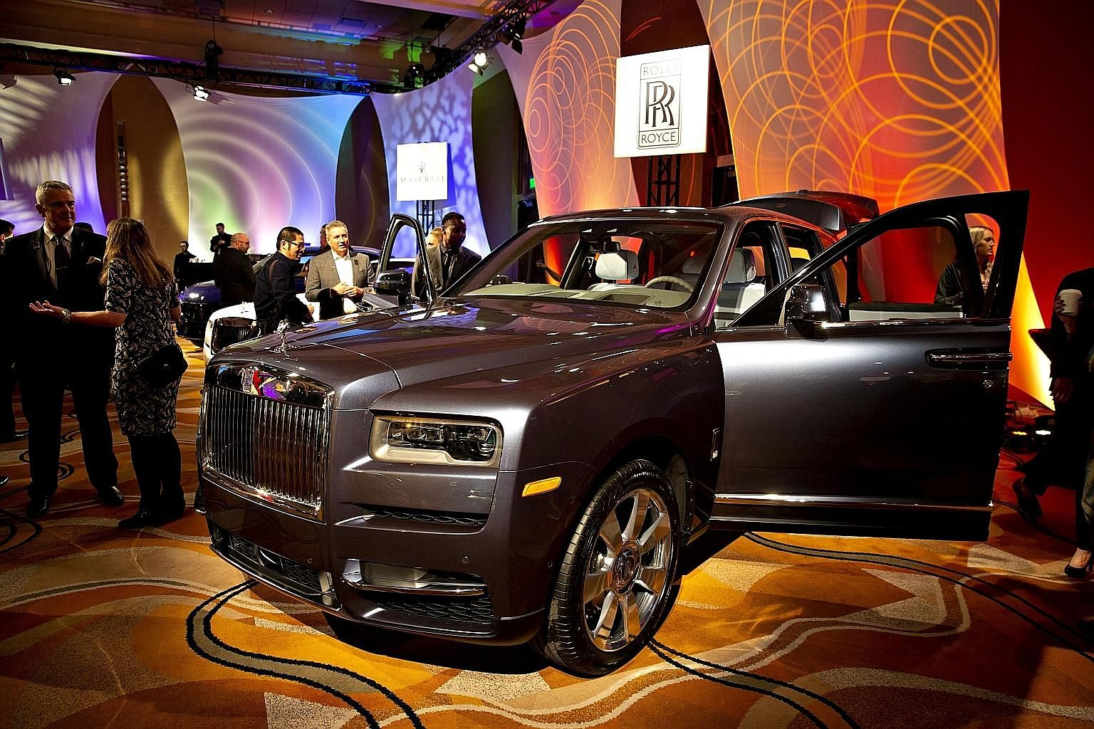The Rolls-Royce Cullinan sport utility vehicle (SUV) was designed with extra amenities that begto be customised: rear work stations trimmed in exotic wood, deep-pile cashmere carpeting, and spots forChampagne coolers,picnic baskets and cigar hu