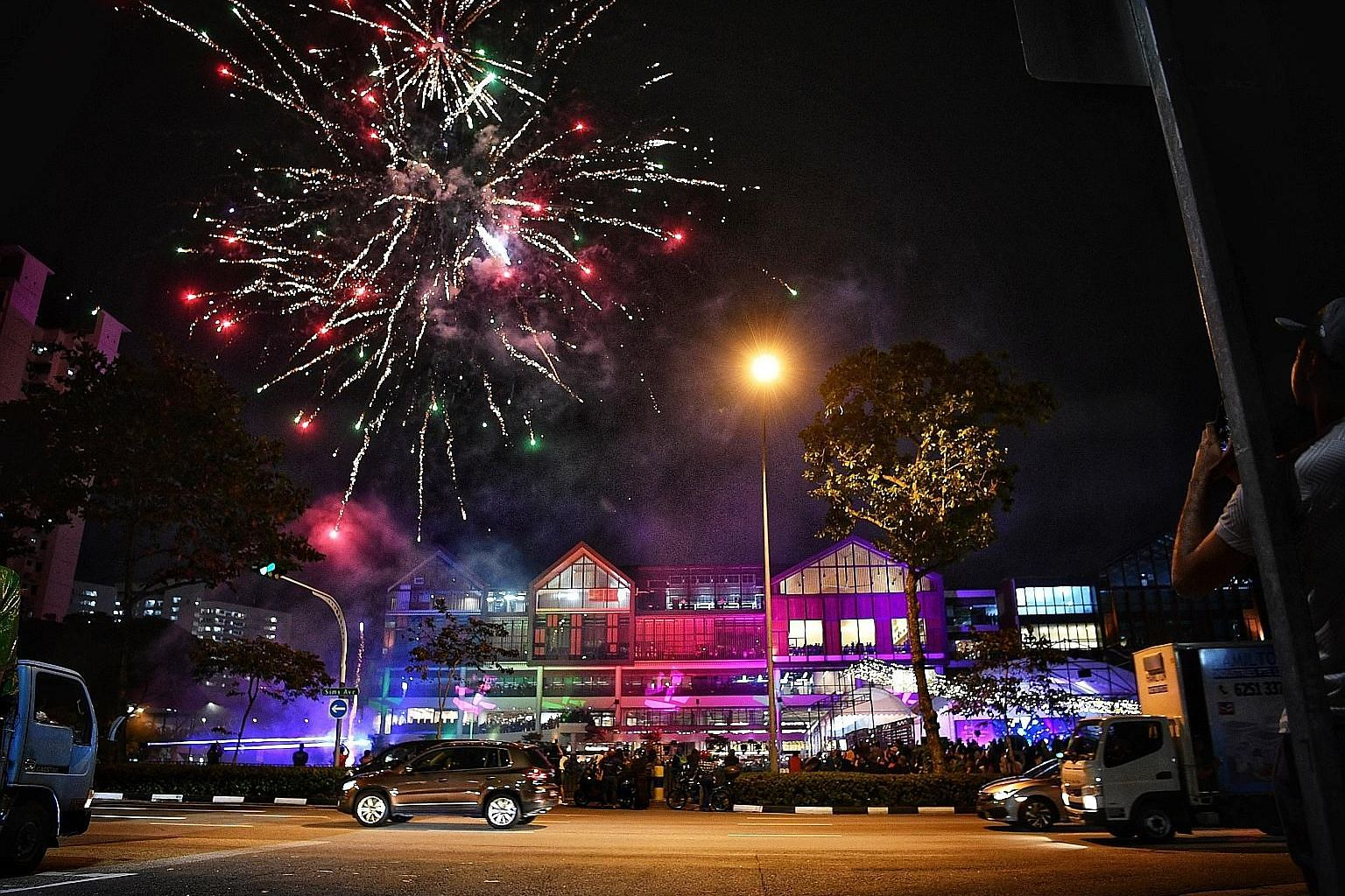 Above: A three-day festival was held in conjunction with the opening, which included fireworks. Left: Wisma Geylang Serai will be the centre stage for a variety of services, programmes and community-based activities.