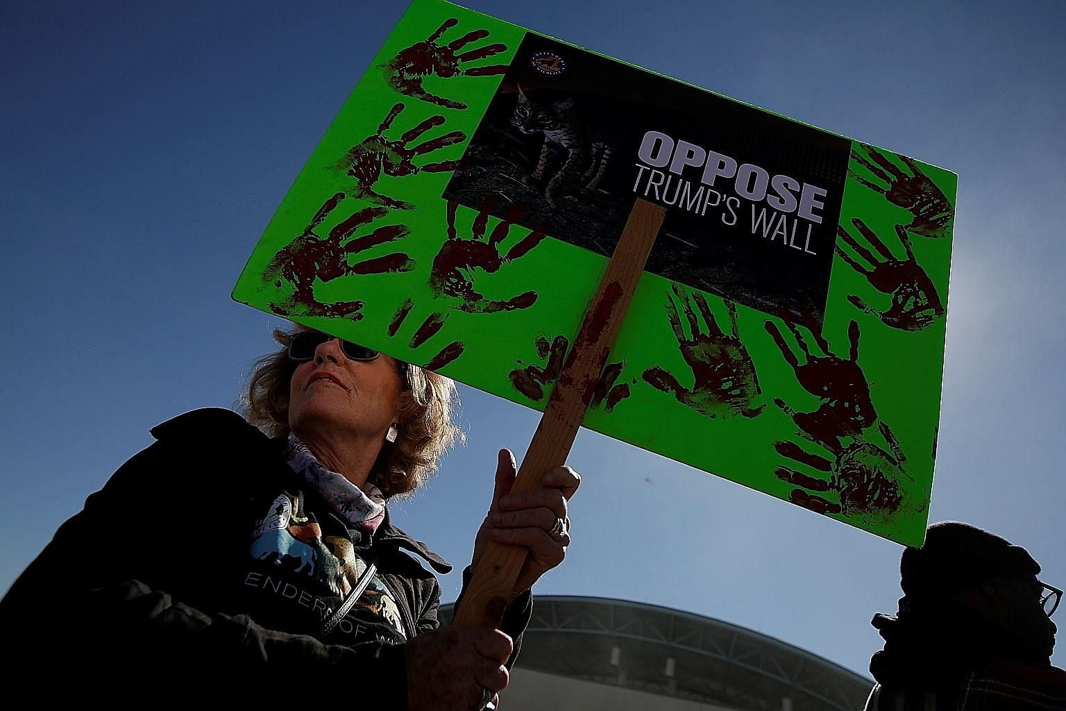 A protester with an anti-wall sign during a march by members of Border Network for Human Rights in El Paso, Texas, on Saturday. Today, relatively few land borders exist to physically fend off a neighbouring power, says the writer. Modern borders exis