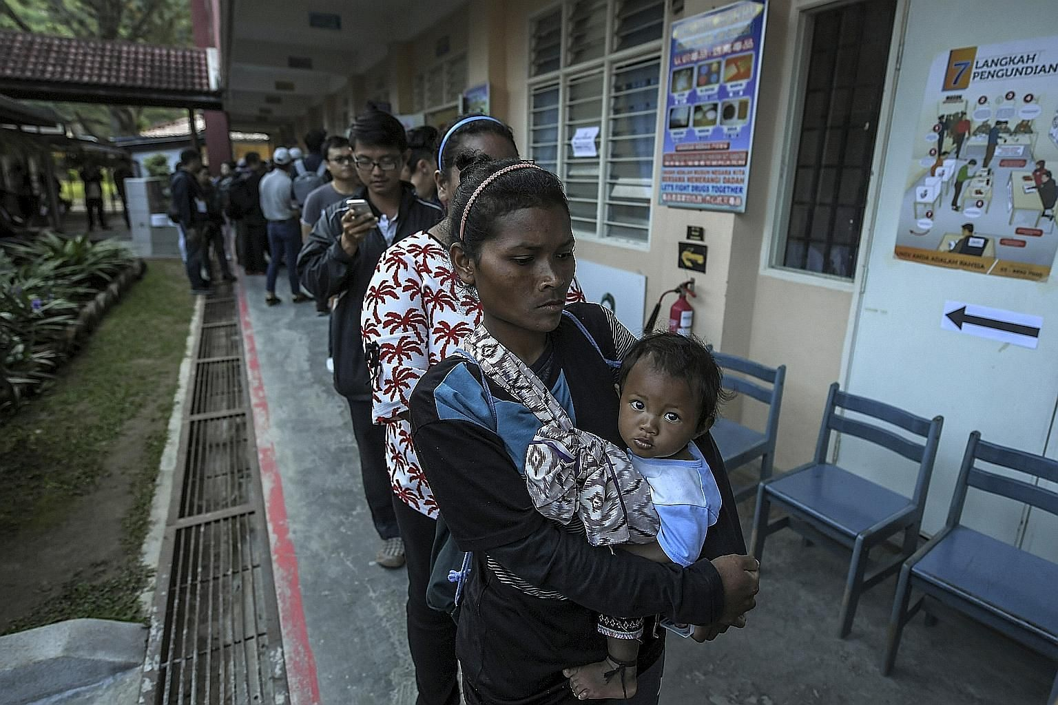Voters queueing up at a polling centre in Bertam Valley to cast their ballots in the Cameron Highlands by-election on Saturday.