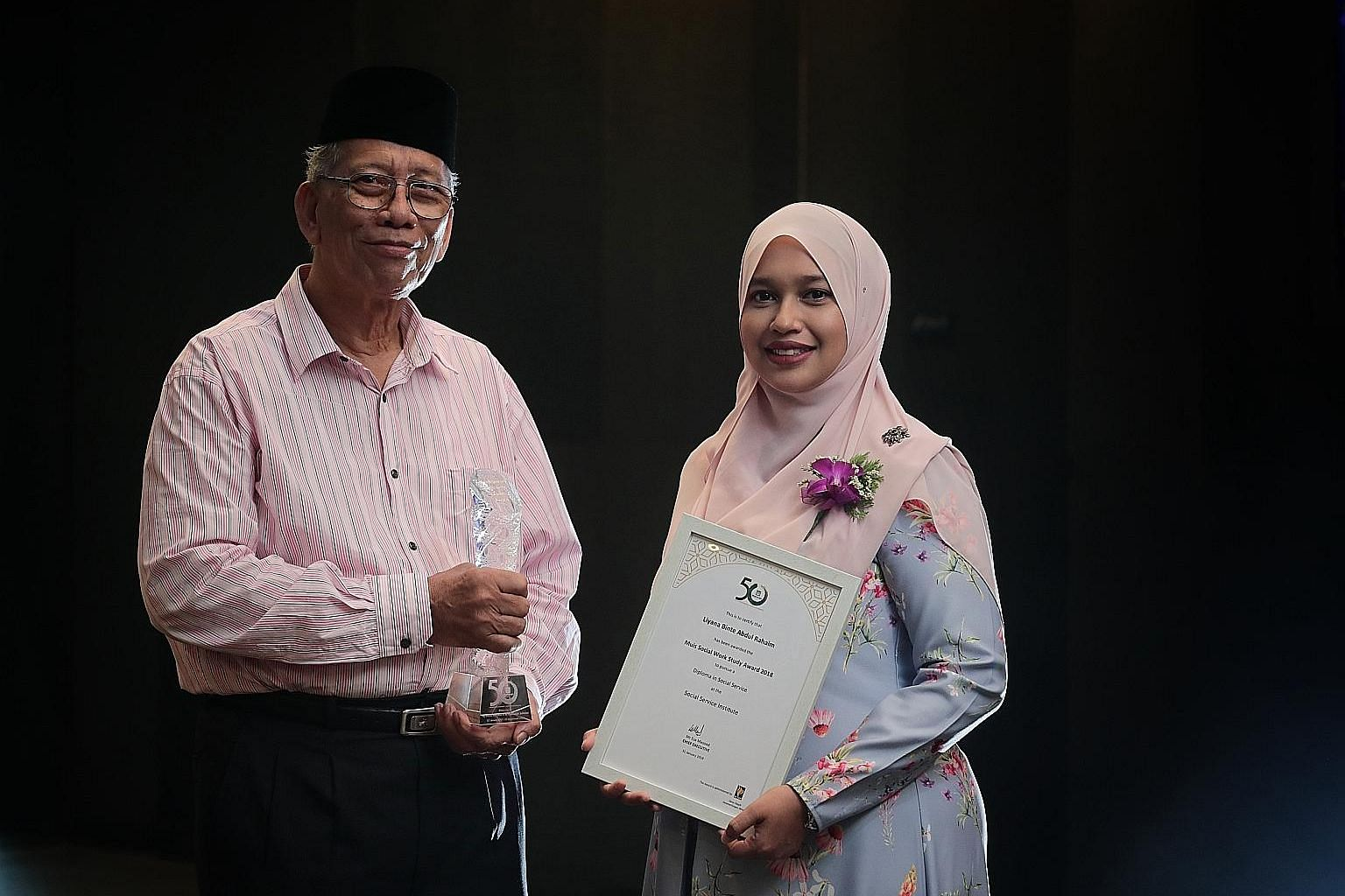 Mr Ma'mun Suheimi received the Muis50 Contemporary Madrasah Leader Award and Ms Liyana Abdul Rahaim was presented with the Muis Social Work Study Award during the Madrasah Teachers Symposium at Suntec Convention Centre yesterday.