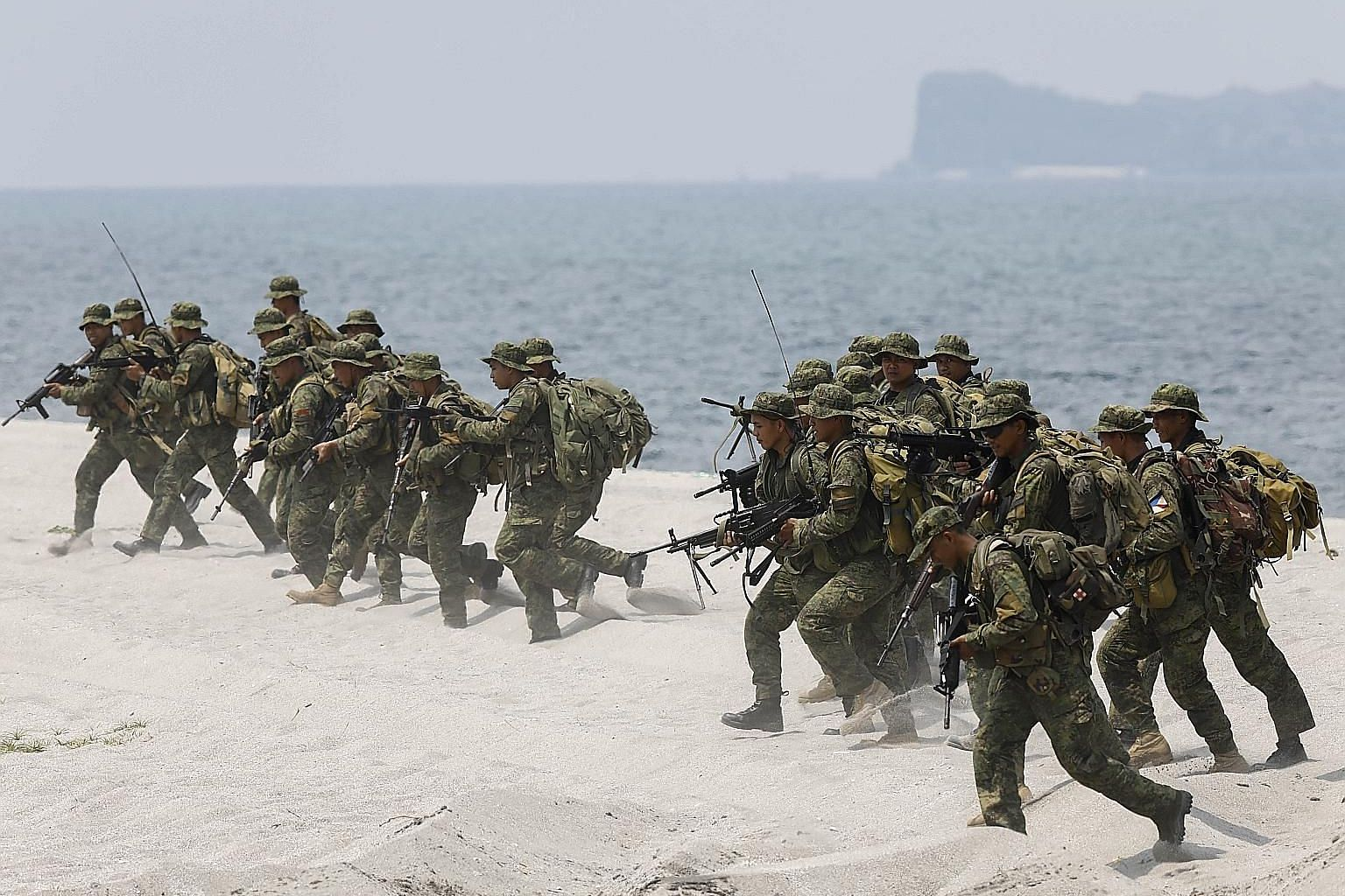 Philippine Marines in a drill with their United States counterparts on a beach in the Philippines last May. The writer says a greater source of concern for Manila is the lack of clarity on the precise geographical scope of the Mutual Defence Treaty a